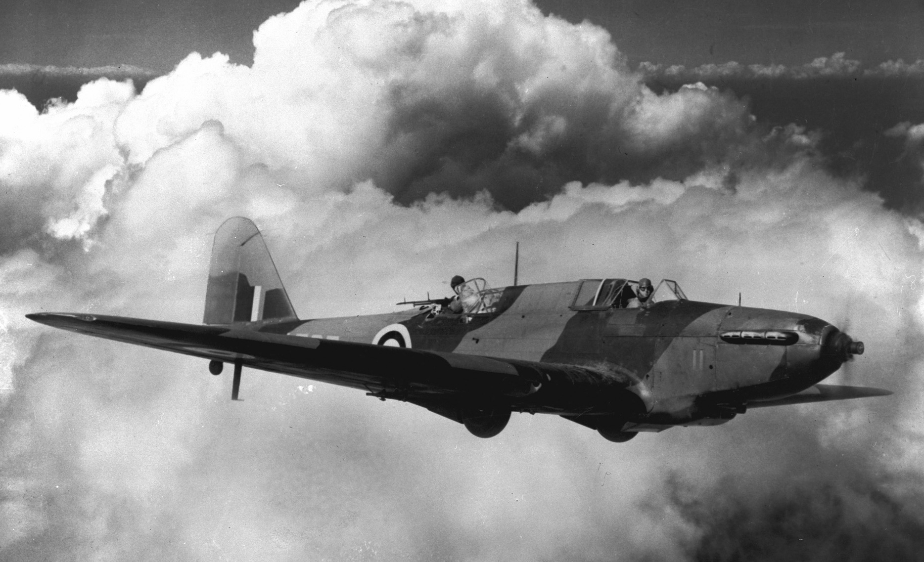 "The original caption of this photo reads: ""Against a background of clouds, a Fairey Battle training bomber flies at a Royal Canadian Air Force Station in Canada. The type is used at bombing and gunnery schools and, while outmoded today as a fighting machine, it proved its worth at Dunkirk."" PHOTO: DND Archives, PL-3039"