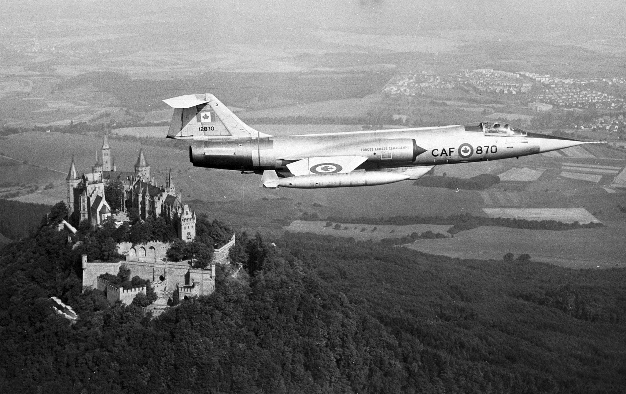 A CF-104 Starfighter from Canada's NATO-assigned No. 1 Air Division flies over Hohenzollern castle in the Federal Republic of Germany. The Air Division was equipped with six squadrons of the jet aircraft and based in Germany. PHOTO: DND Archives, IL69-64-1