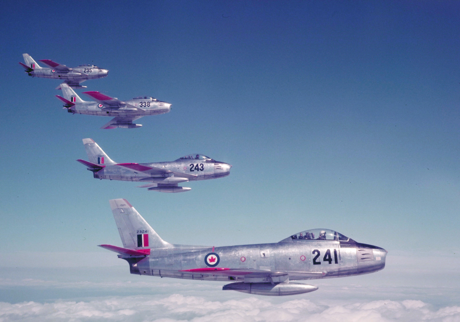 Four Mk V F-86 Sabre jet aircraft from RCAF Station Chatham, New Brunswick, fly in formation at the International Air Display in Toronto. PHOTO: DND Archives, PC-1311