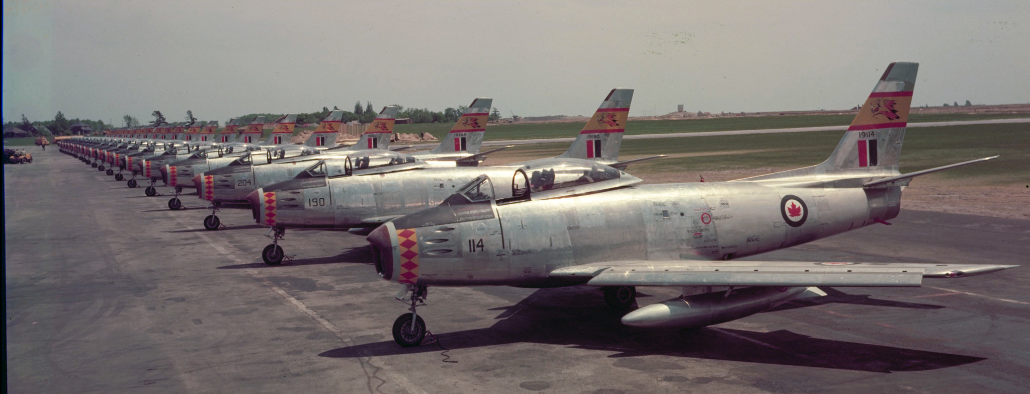 F-86 Sabres from 439 Squadron are lined up on the tarmac at Uplands in Ottawa. PHOTO: DND Archives, PC-81