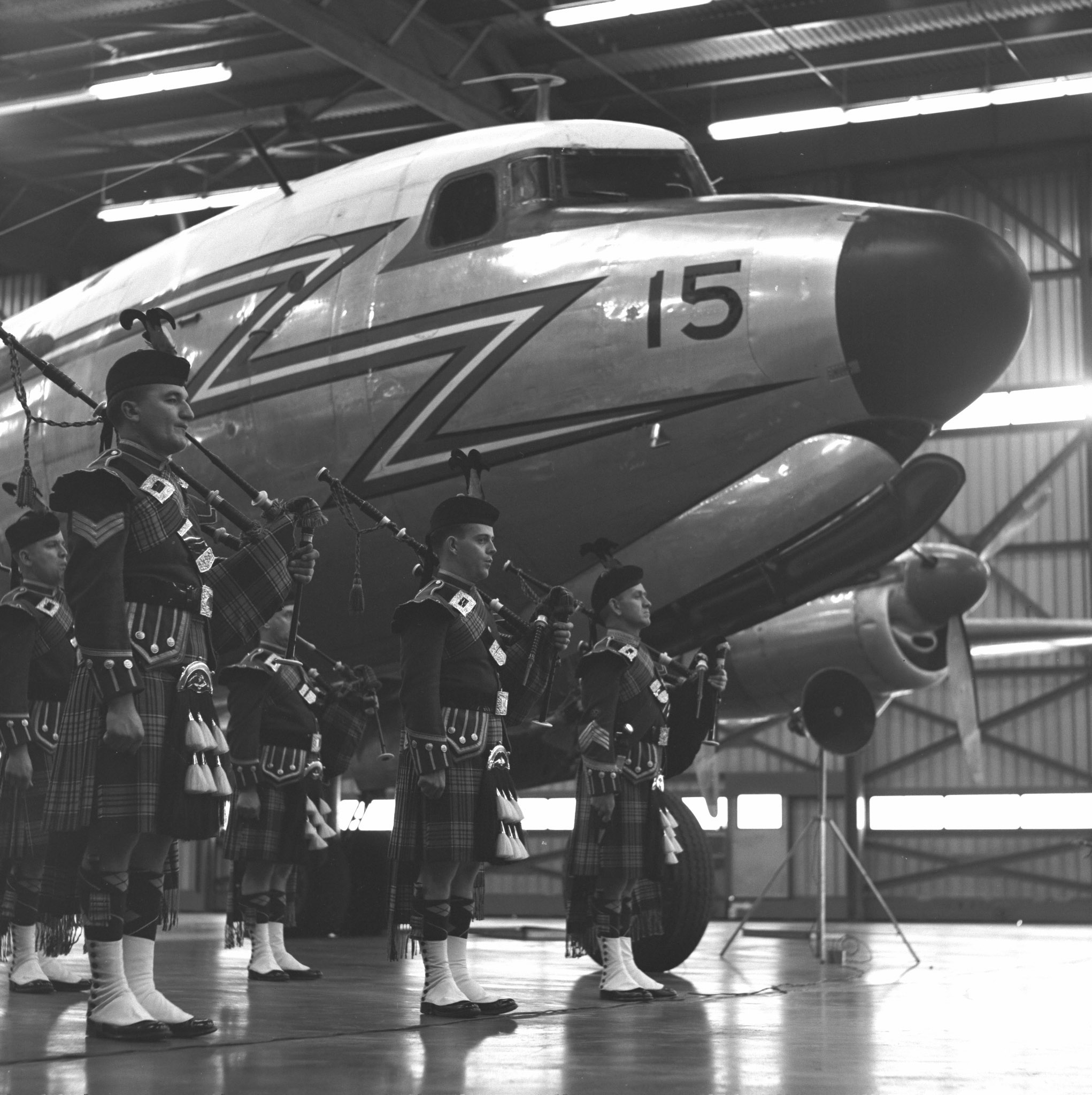 The RCAF Pipe Band stands in front of the RCAF's last North Star during the aircraft's retirement ceremony.