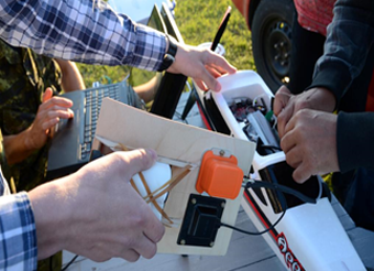Figure 6 shows the Bluejay hardware being installed in a miniature remote-controlled airplane. End Figure 6.