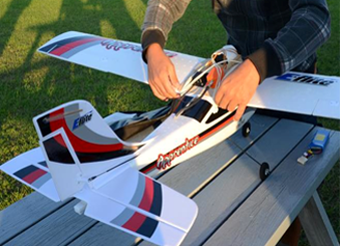 Figure 7 shows the remote-controlled airplane receiving some final adjustments just prior to takeoff. End Figure 7.