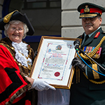 The Town Mayor of Folkestone, Councillor Ann Berry presents Brigadier-General Lowell Thomas, Commanding Officer, Canadian Defence Liaison Staff London, with the town's Freedom of Entry scroll, 4 July, 2018.  PHOTO: MCpl Boucher