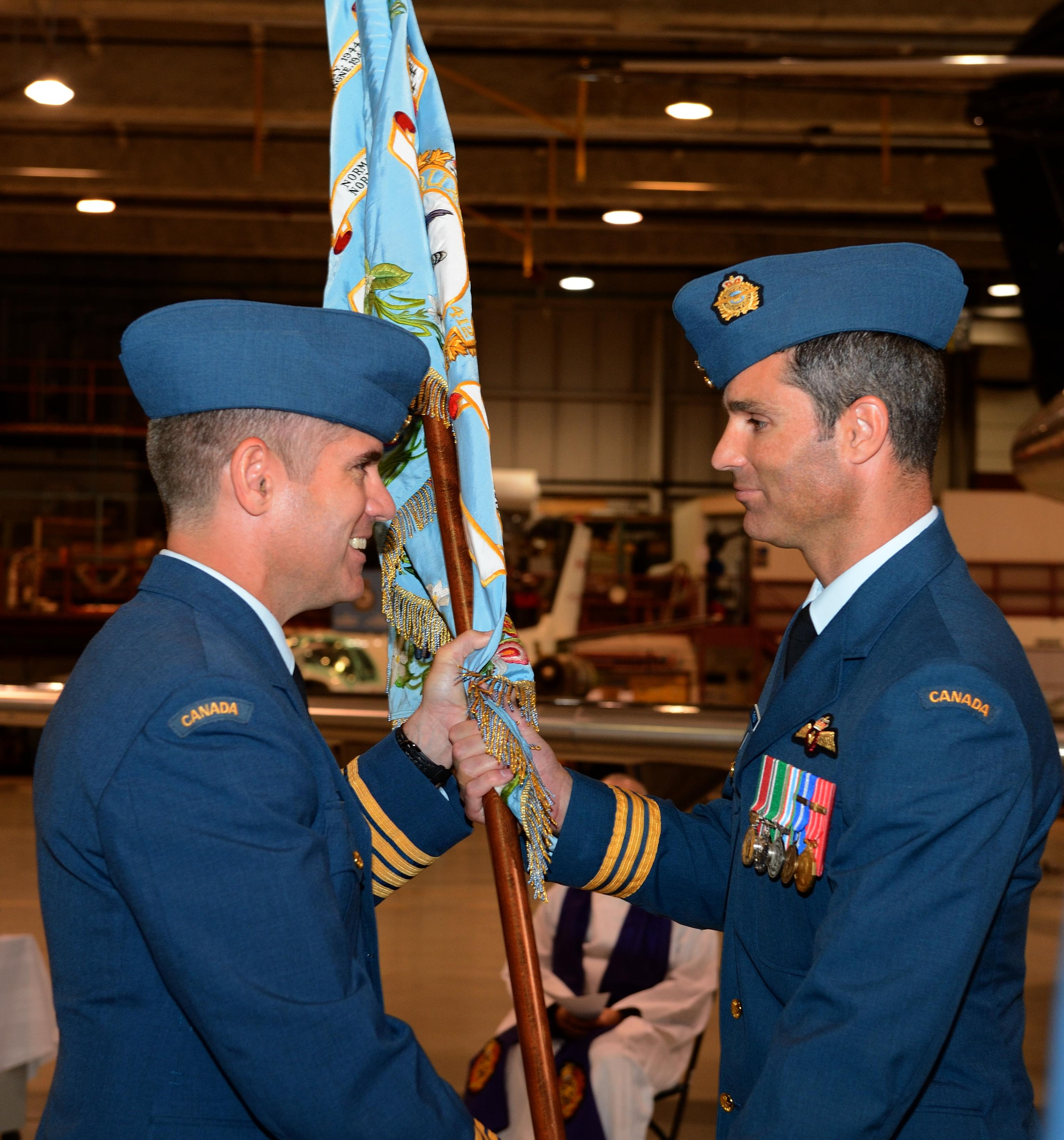 Passing of the Colours by Col Sean Friday to LCol Michael Thornley.