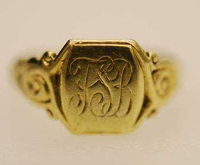 "A gold ring, inscribed with ""TSB"", belonging to LAC Bates. PHOTO: Submitted."