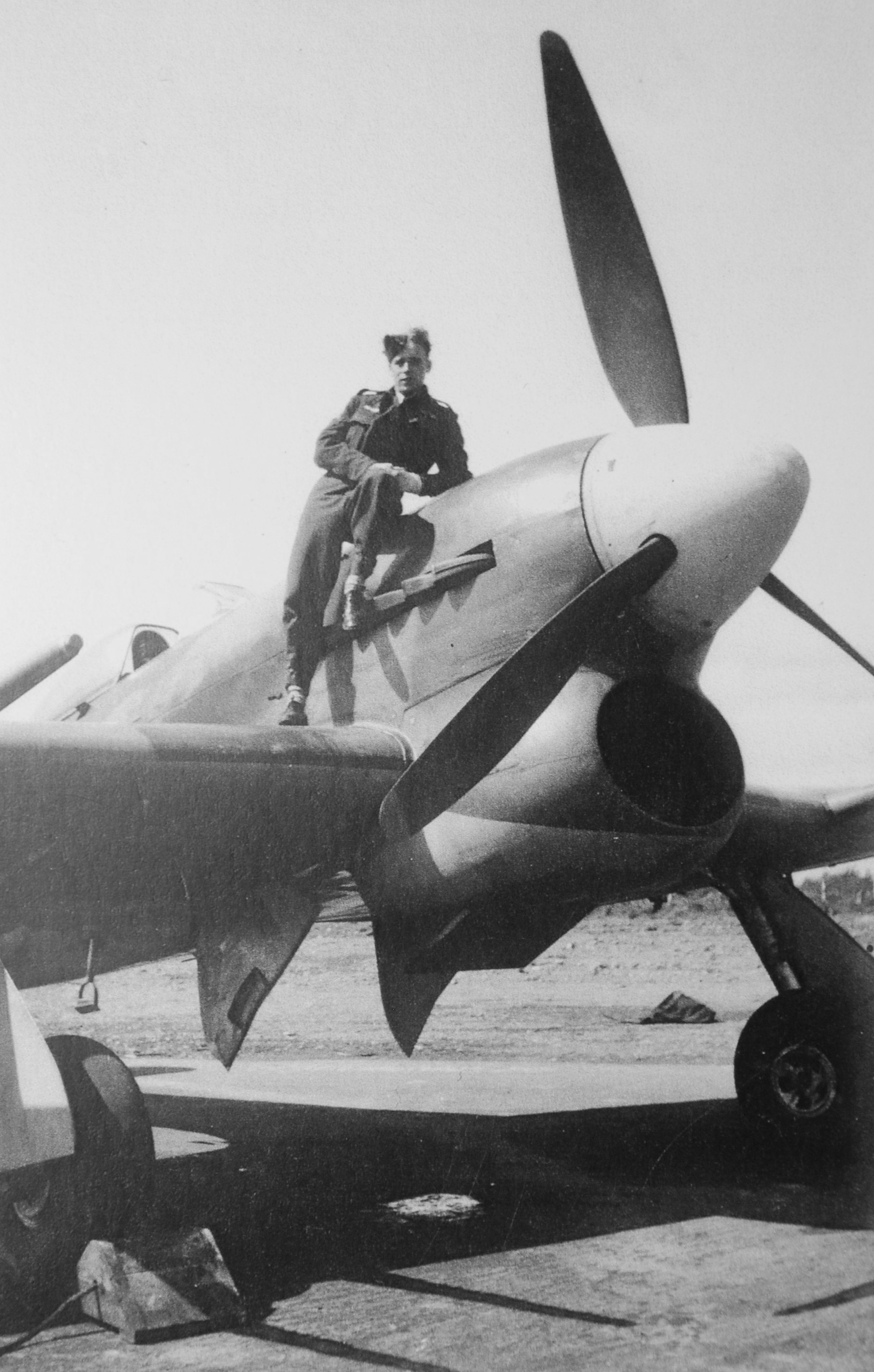 Flight Lieutenant John Colton perches on his Hawker Typhoon in Manston, England, in July 1944.