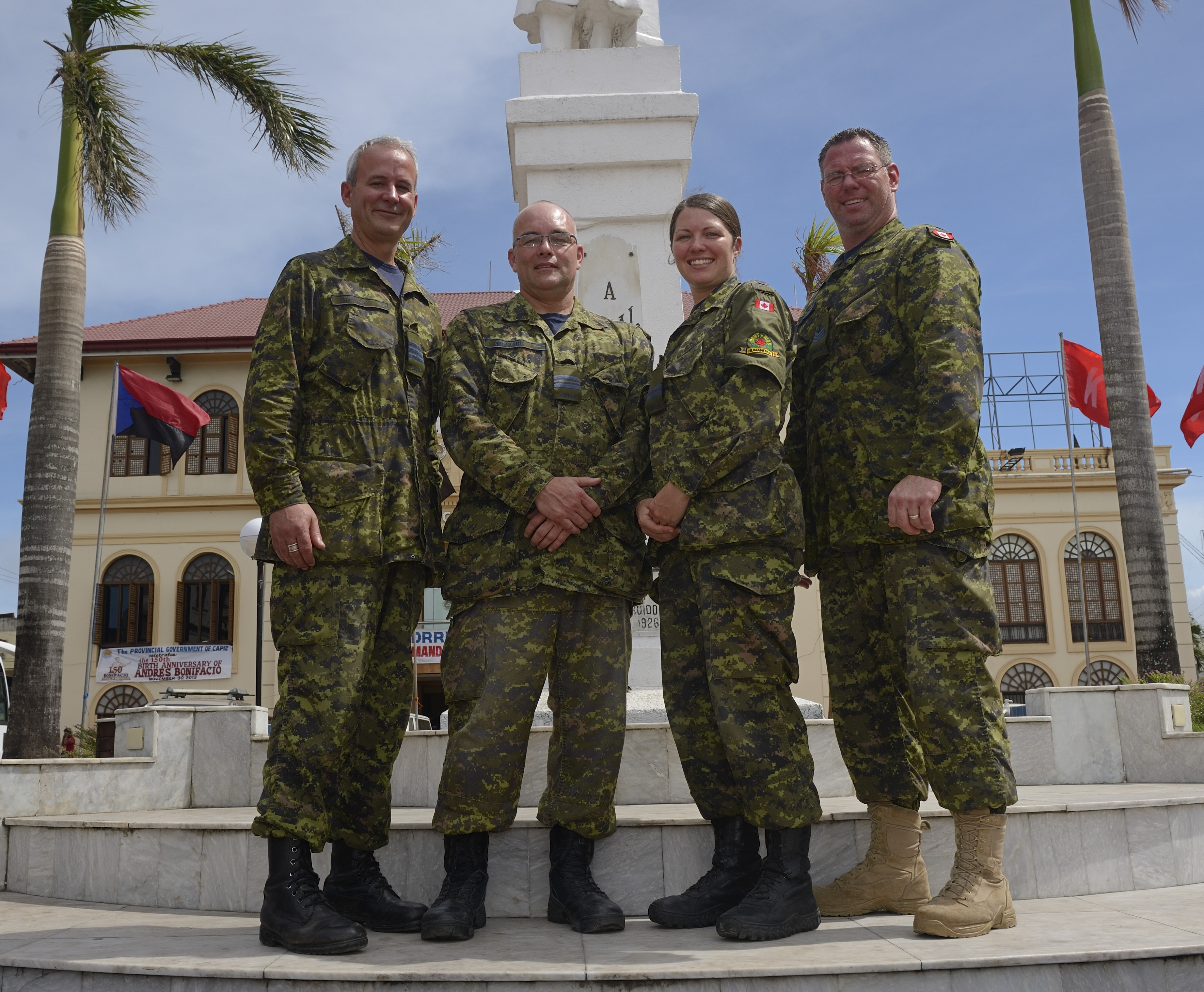 (Left to right) Lieutenant Colonel Sabin Tremblay, Major Stephann Gregoire, Captain Janaya Hansen, and Sergeant Francis Jerdon in Roxas, Philippines on November 29, 2013. All are members of 2 Wing Bagotville Quebec. PHOTO: Corporal Ariane Montambeault