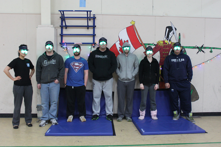 Seven subjects from the treatment group pose with their luminescent green visors.