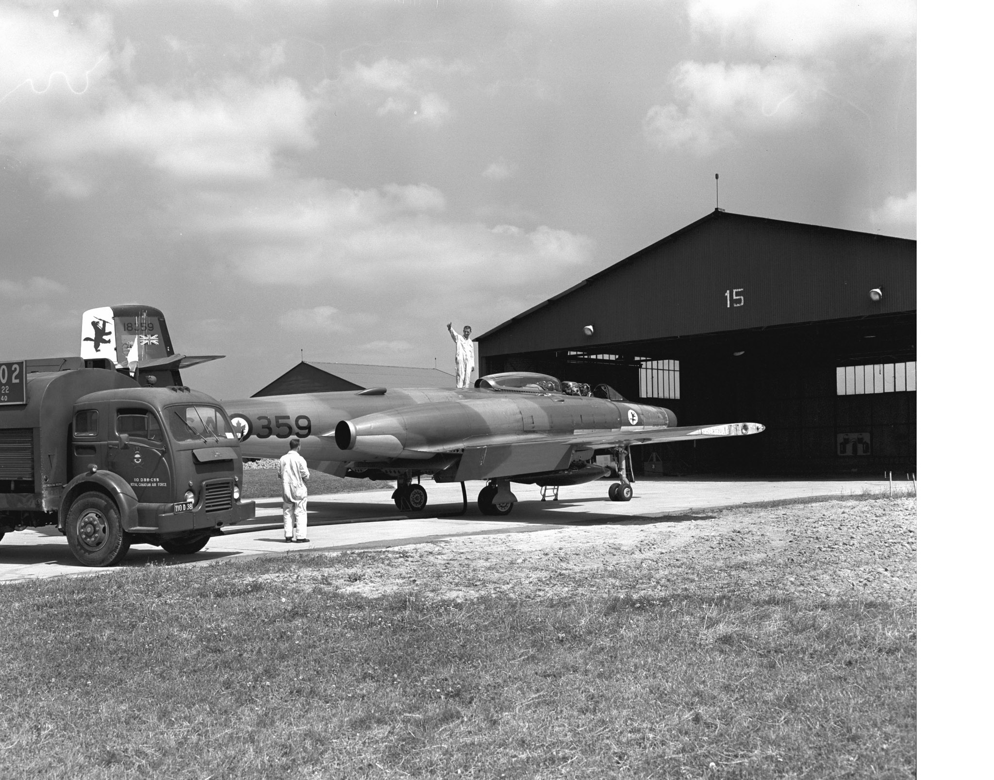 An Avro Canada CF-100 Canuck all-weather jet interceptor is refuelled ...