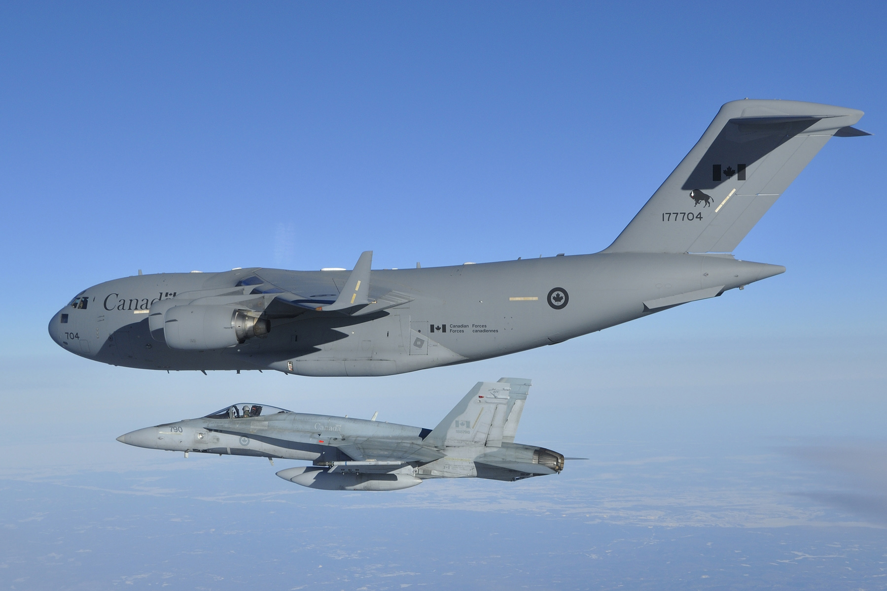 A CC-177 Globemaster III from 429 Transport Squadron, piloted by Captain Capt Dave Hicks, arrives in Ottawa on March 18, 2014. The last Canadian troops to leave Afghanistan were onboard the historic flight. The Globemaster was escorted by two CF-18 Hornet fighter jets from 425 Tactical Fighter Squadron, 3 Wing Bagotville, Quebec. PHOTO: DND