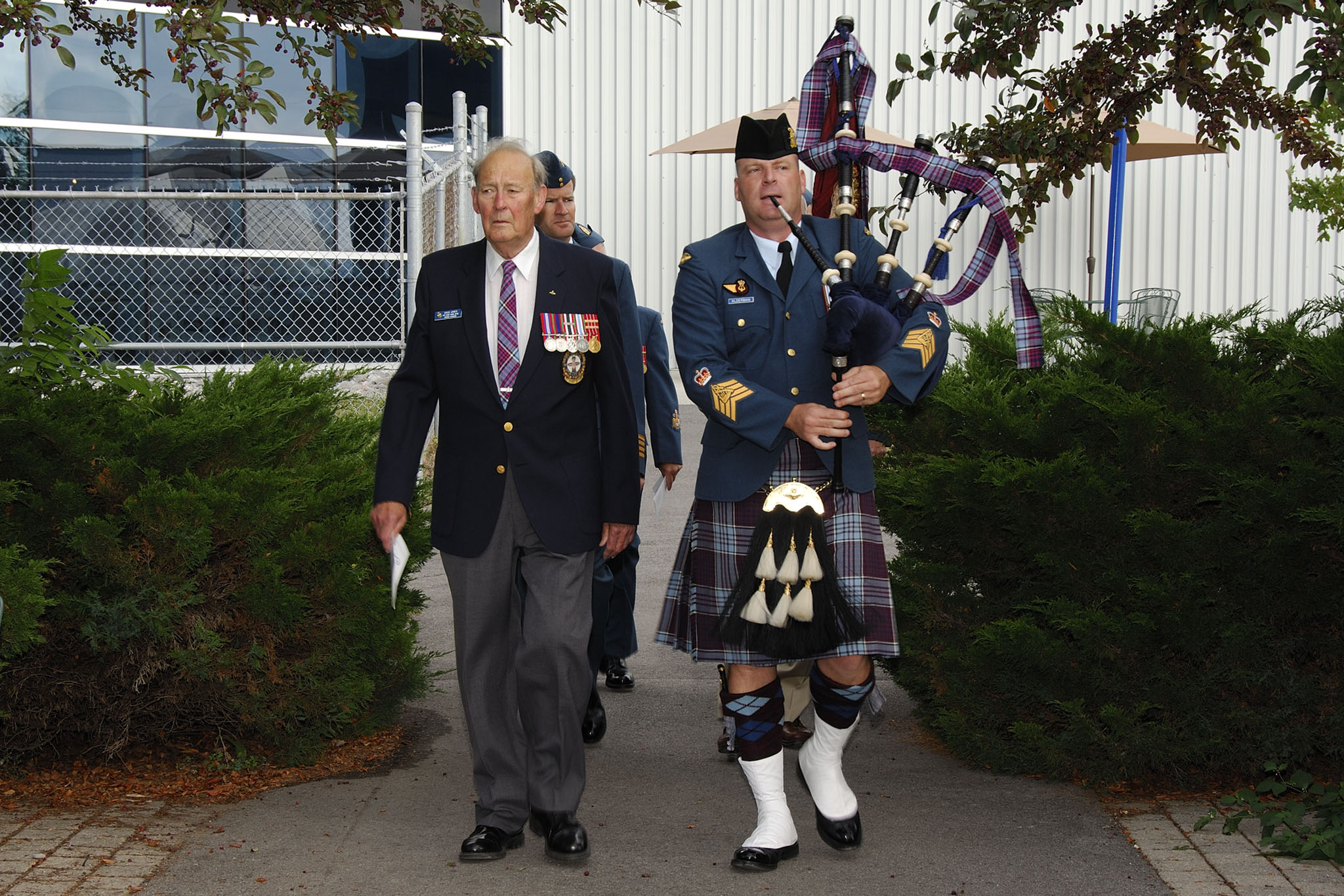 "Mr. Doug Jones (left), President of 426 Thunderbird Squadron Association, with Piper Warrant Officer Sean Alderman (right), wearing the RCAF tartan, during 426 ""Thunderbird"" Squadron Association's Memorial Service on August 15, 2007, at 8 Wing Trenton. PHOTO: Private Isabel Lavallee-Raby"