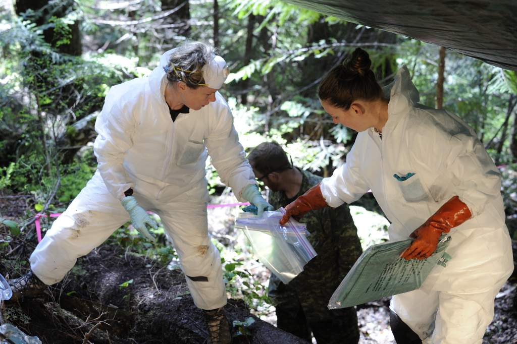On May 5, 2014, Ms Courtney Brown, coroner, British Columbia Coroners Service (right) and Ms Laurel Clegg, a forensic scientist and casualty identification coordinator with the Directorate of History and Heritage in Ottawa, conduct an initial survey and recovery of the remains of four airmen from th