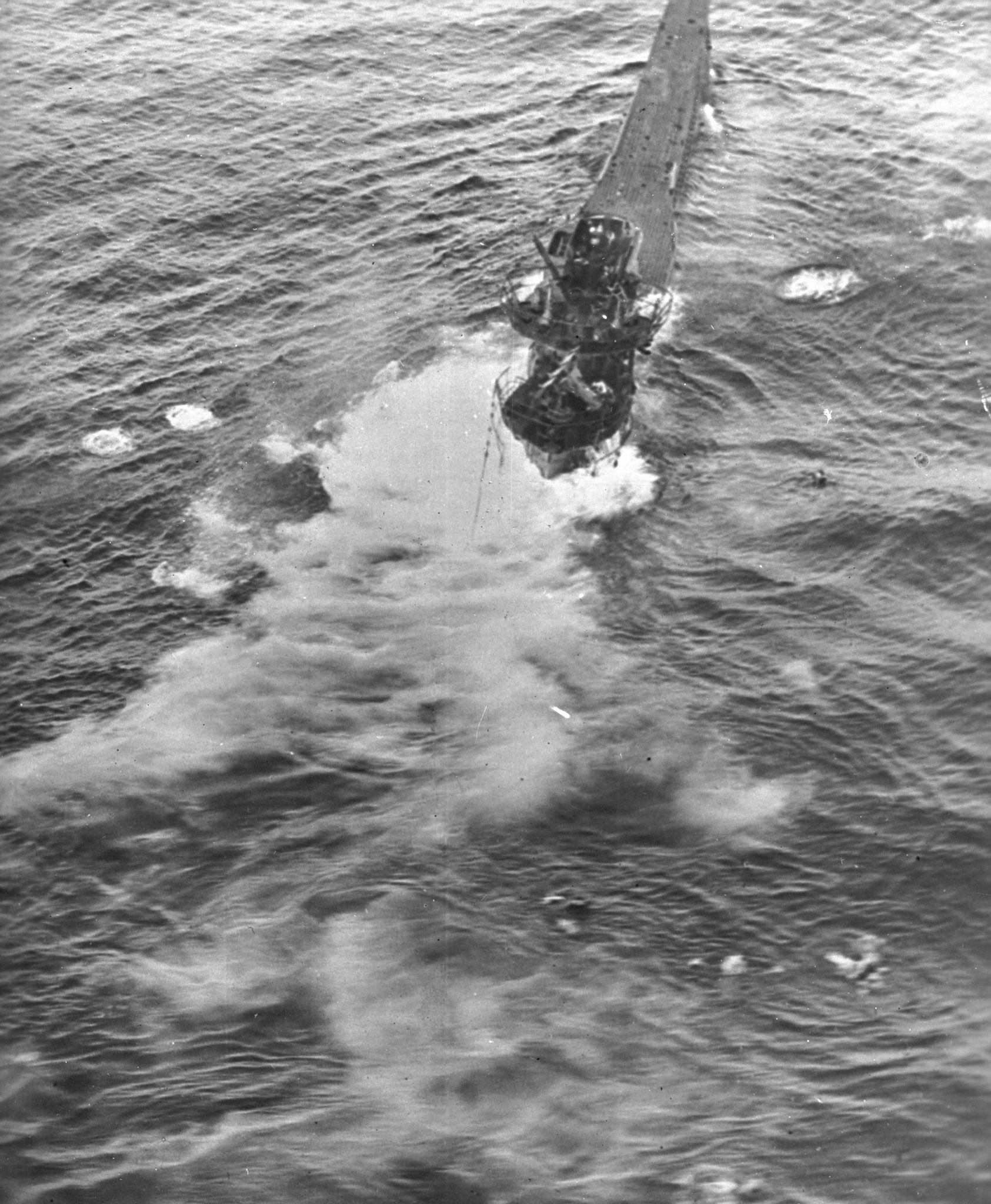Coastal Command's first U-boat kill of 1944. The Sunderland's gunners put a final burst of fire across the U-boat's six and a half minutes after the first sighting; a few seconds later the U-boat disappeared beneath the surface. Survivors can be seen in the water at the bottom right of the photo. PHOTO: DND Archives, PL-61430