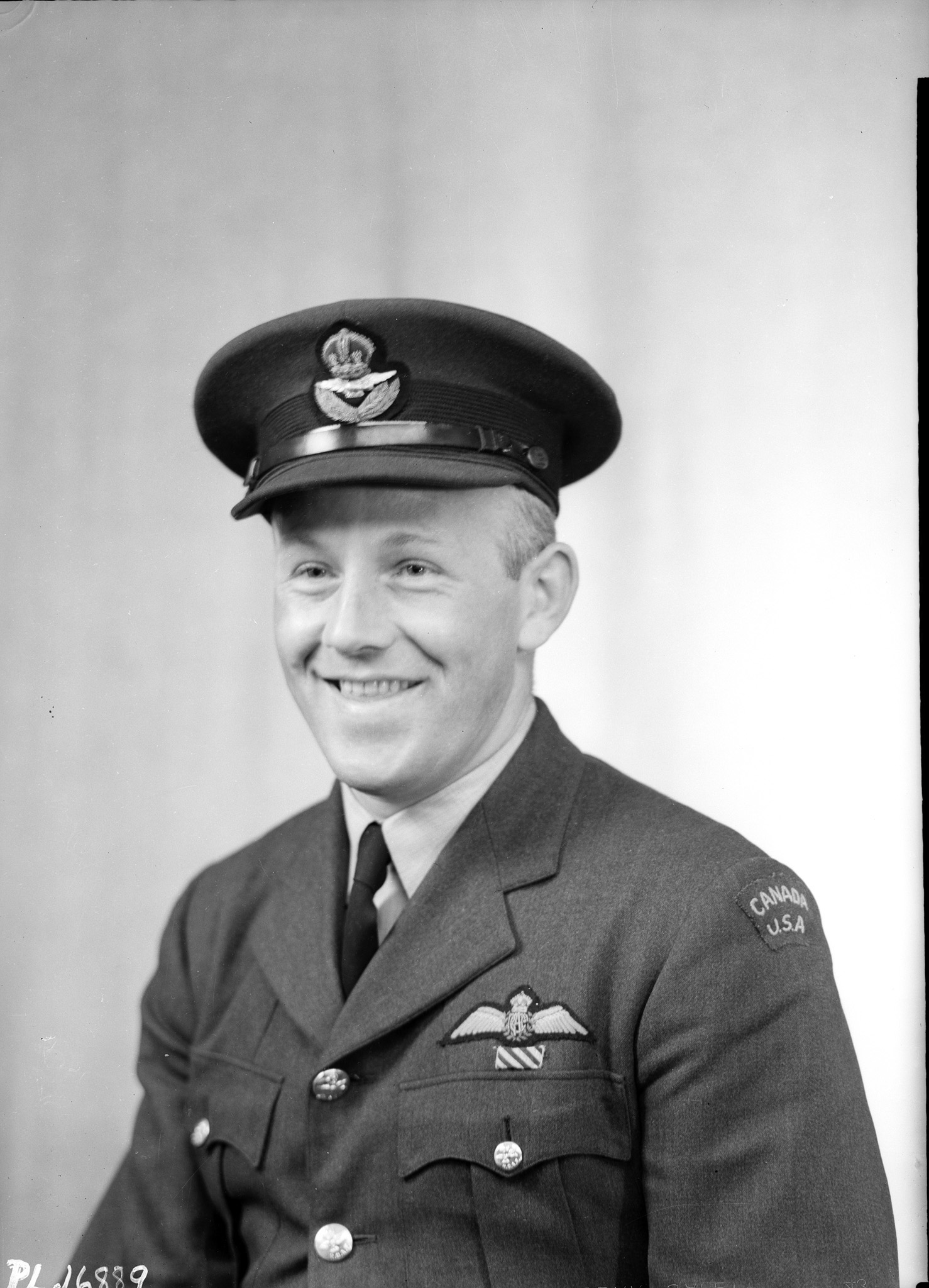 "Flight Lieutenant Joseph Charles ""Joe"" McCarthy, an American, was a member of the RCAF and a pilot during the raid. He survived the war, remained in the RCAF and eventually became a Canadian citizen. This photo was taken in London, England, shortly after the raid. PHOTO: DND"