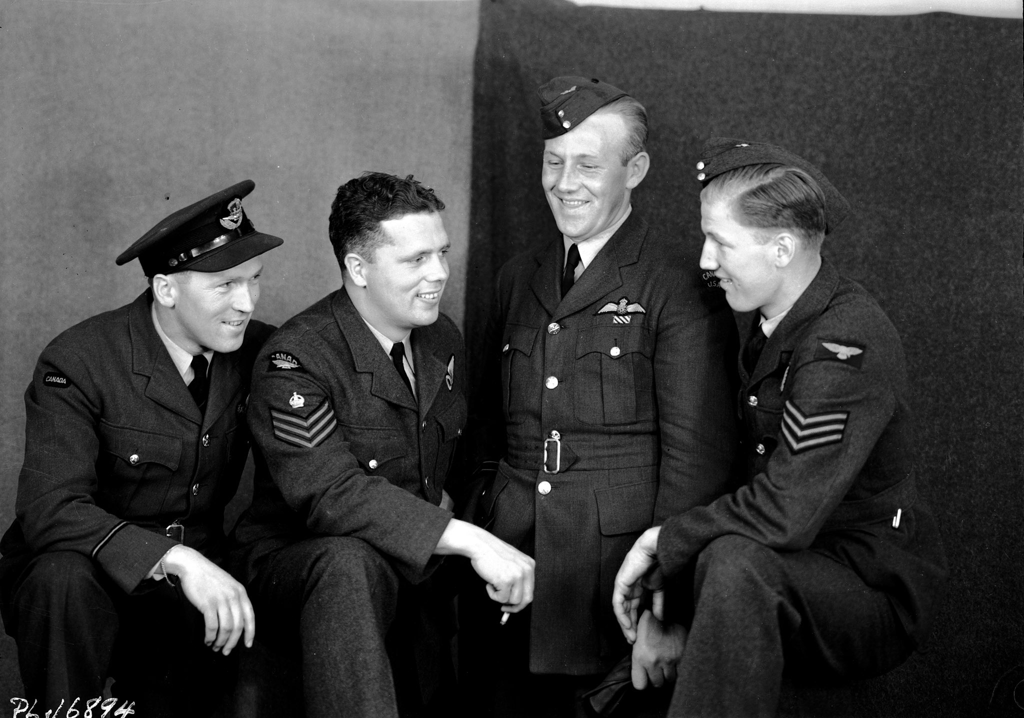 "A group of RCAF personnel who took part in the Dambusters raid was photographed while on leave in London, England, shortly after the operation. From left to right:  Flight Lieutenant David Rodger, Flight Sergeant Donald A. MacLean, Flight Lieutenant Joseph Charles ""Joe"" McCarthy and Sergeant William Radcliffe.  PHOTO: DND"