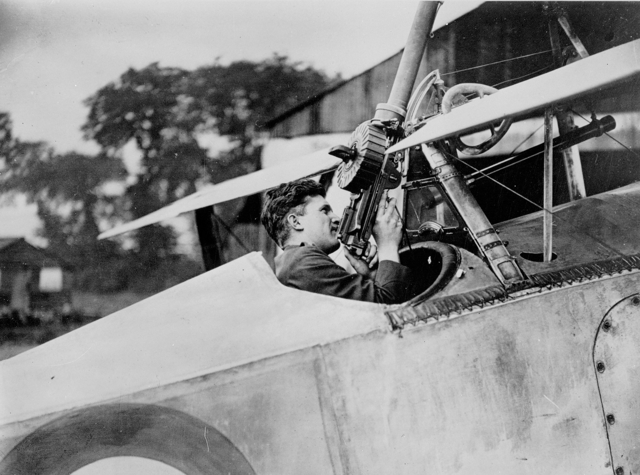 Captain Billy Bishop, seated in his Nieuport Scout aircraft, checks the action on his Lewis gun on August 6, 1917. PHOTO: DND Archives, AH-407B