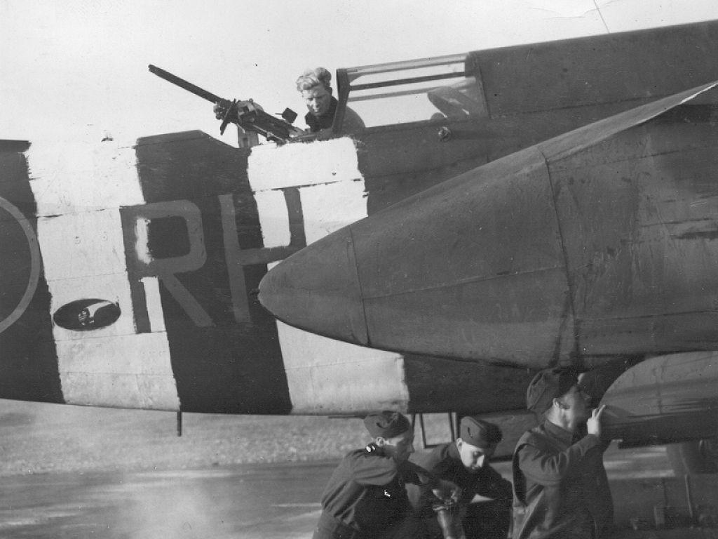 Crudely painted invasion stripes are seen on the rear fuselage of a Royal Air Force Douglas Boston. Aircraft that participated in the D-Day invasion were painted in these easily recognizable stripes so they would not be confused with enemy aircraft. PHOTO: RAF