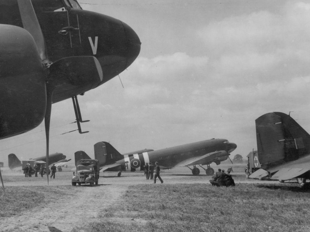 C-47 Dakota transports configured for casualty evacuation wait to fly into the invasion area. PHOTO: RAF