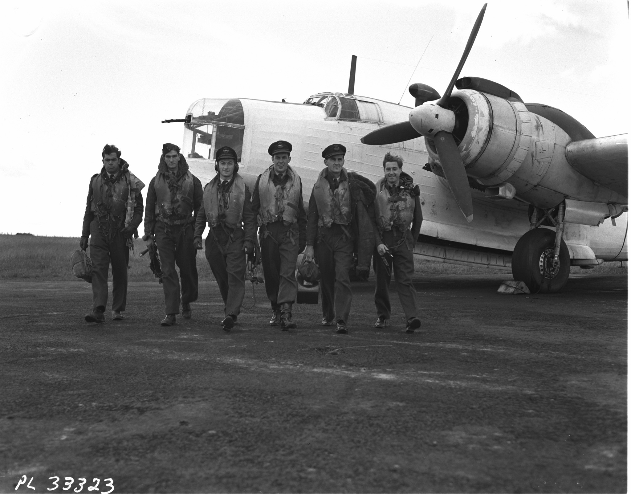 "The first 407 ""Demon"" Squadron crew to take off on D-Day. Left to right: Sergeant C.T. Bryan, Sergeant J. Smith, Flying Officer I. Hoffman, Flying Officer Corrigan, Flying Officer M.N. Gilchrist and Pilot Officer E. Bowler. PHOTO: PL-29837, DND Archives"