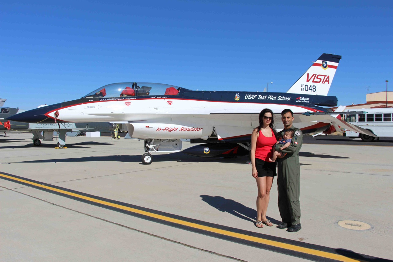 Major Jameel Janua, his wife Sylvie Villeneuve, and their son stand in front of a United States Air Force Test Pilot school Vista jet. Major Janua recently received the Liethen-Tittle Award for being the top student on his course at the United States Air Forces Test Pilot School at Edwards Air Force