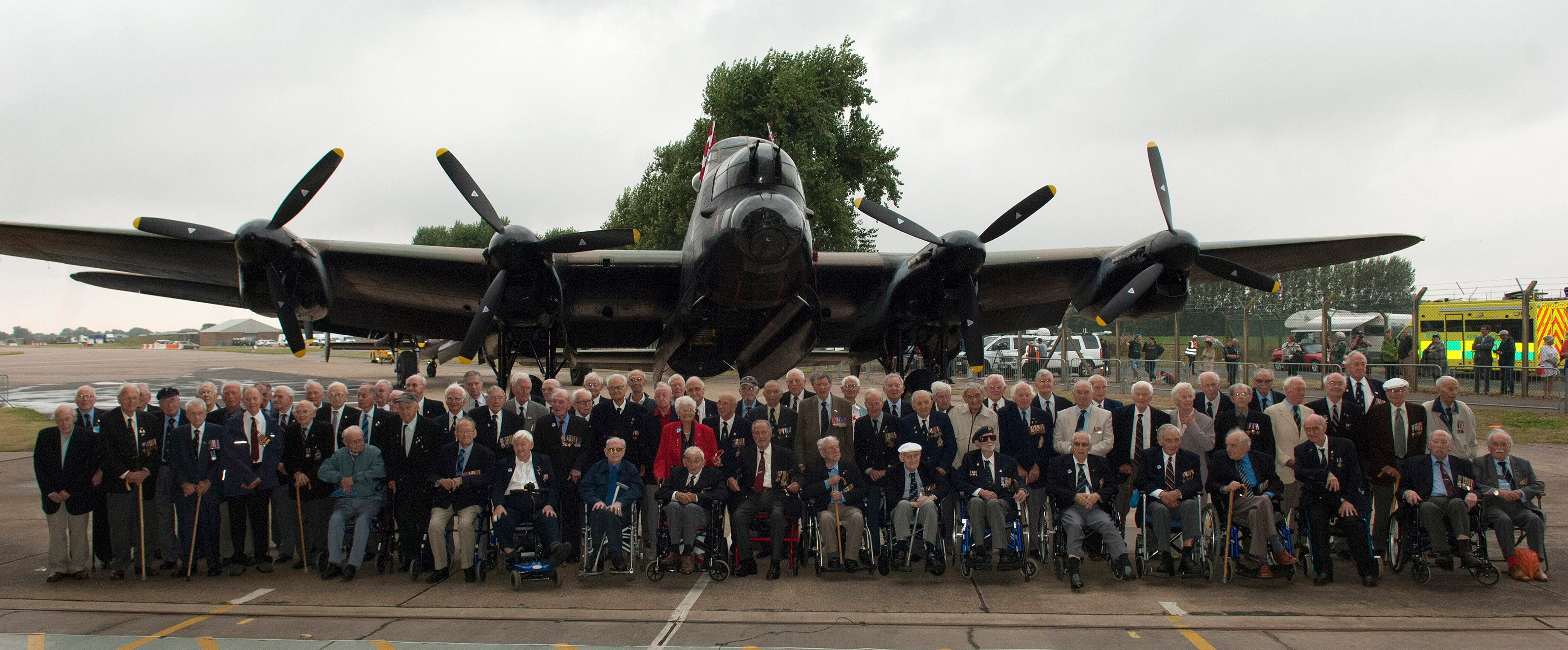 British veterans of Bomber Command gathered to receive their Bomber Command clasps at a ceremony at RAF Coningsby on August 14, 2014. The aircrew re-united to welcome in the Canadian Lancaster and then received their clasps from the station commander of RAF Coningsby, Group Captain Johnny Stringer. PHOTO: MoD Crown Copyright 2014