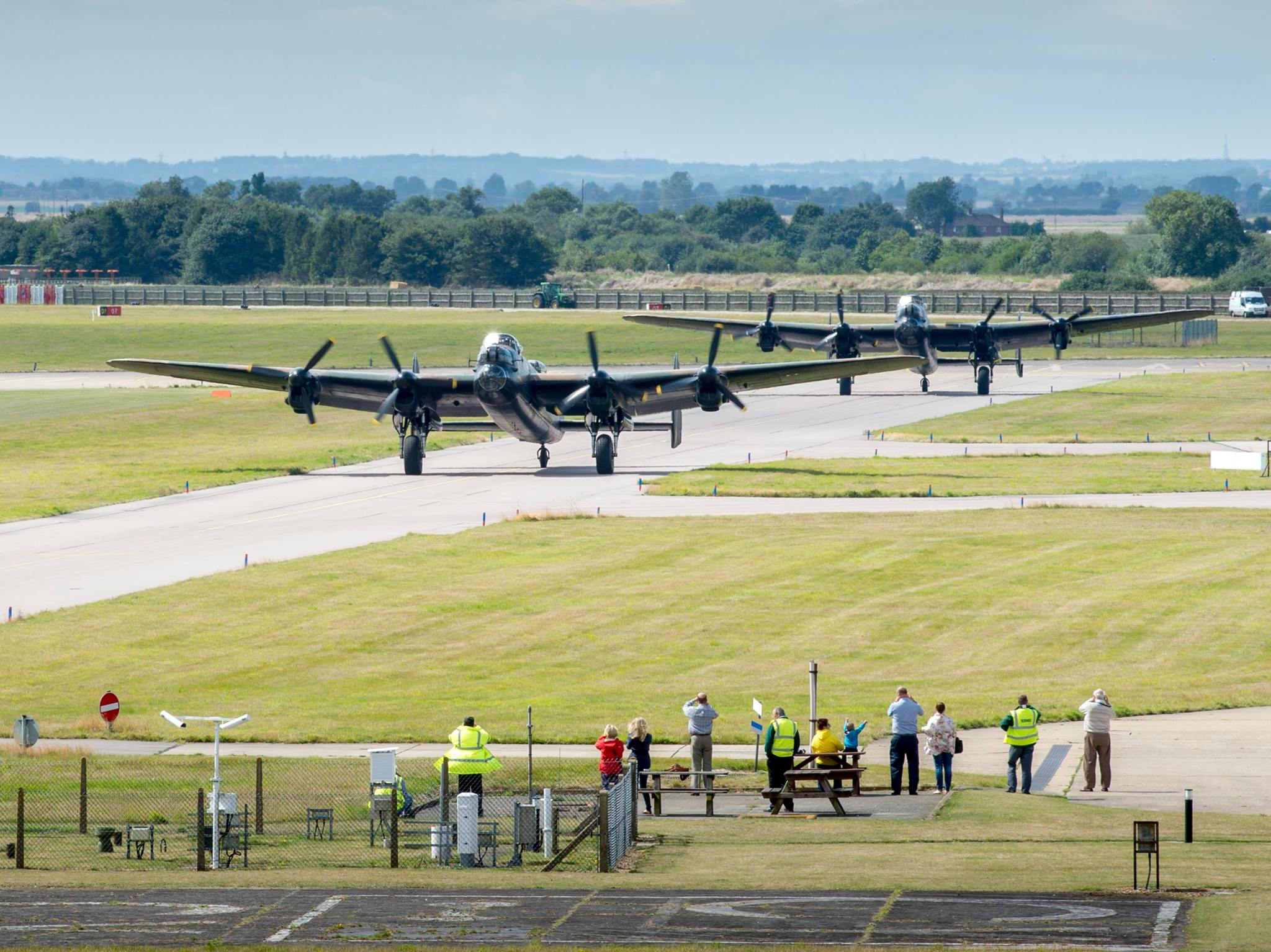 The Canadian and the British Lancaster bombers prepare to take flight at RAF Coningsby, United Kingdom. PHOTO: Gordon Elias, MoD Crown Copyright 2014