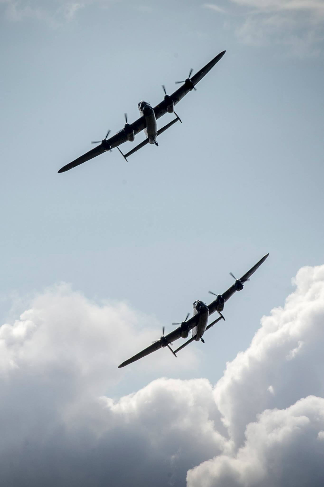 The Canadian and British Lancasters take to the skies on August 14, 2014 – the first time two Lancasters had flown together in more than 50 years. PHOTO: Gordon Elias, MoD Crown Copyright 2014