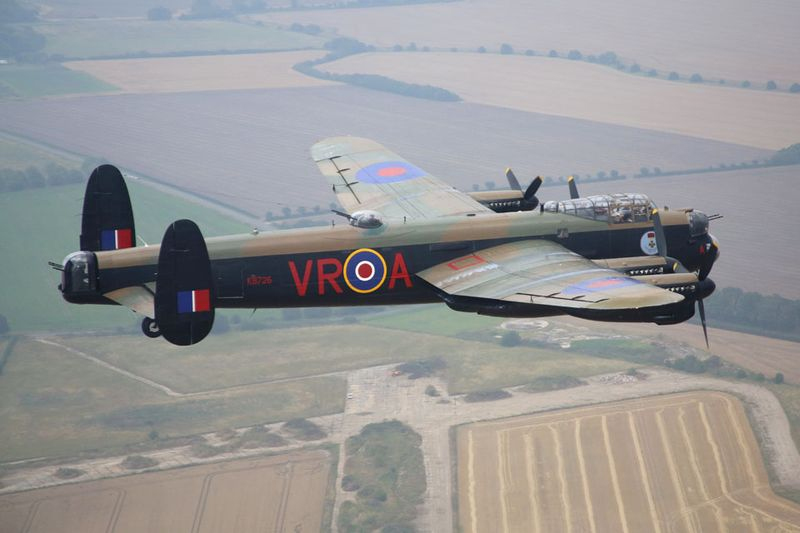 "The Canadian Lancaster nicknamed ""Vera"", from the Canadian Warplane Heritage Museum in Hamilton, Ontario, makes its final approach to RAF Coningsby in the United Kingdom. PHOTO: Senior Aircraftman Adam Fletcher, MoD Crown Copyright 2014"