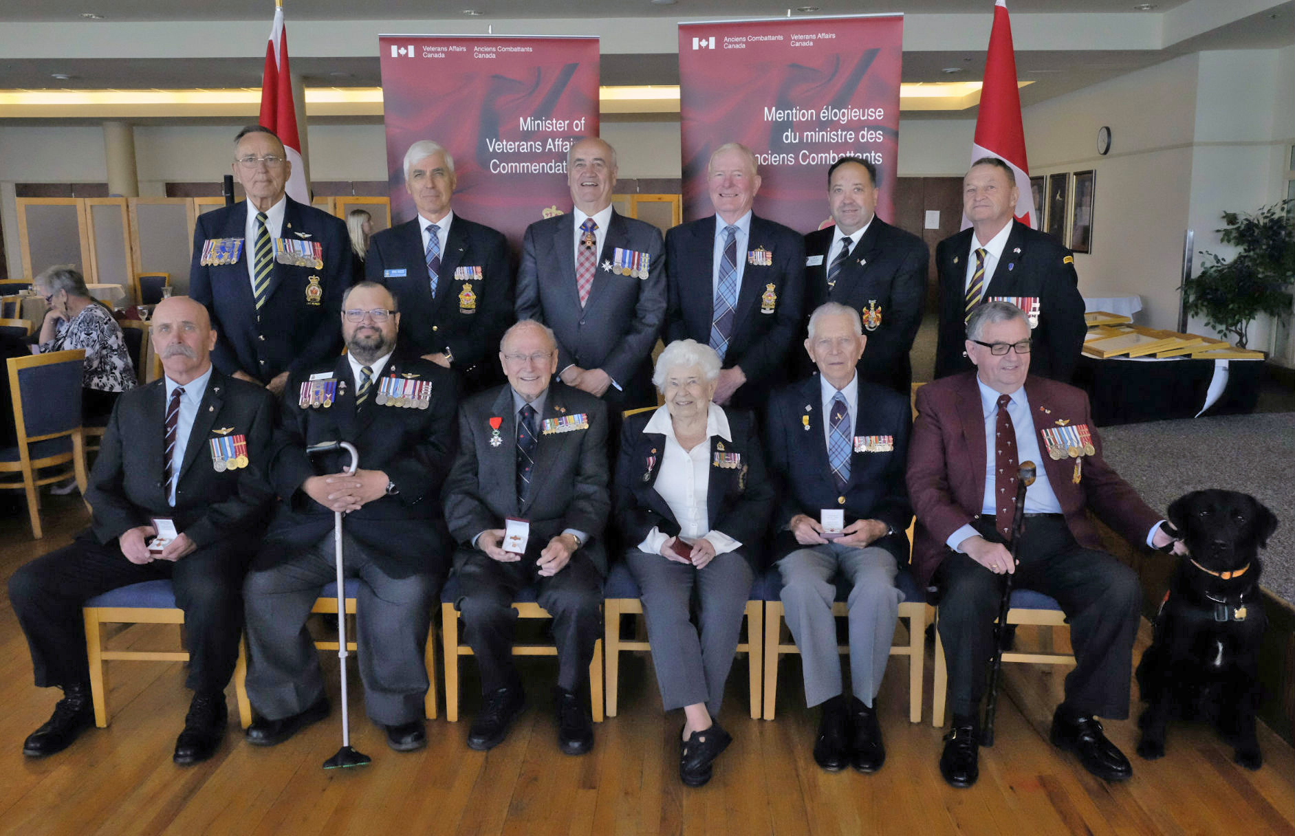 "The 11 Canadians who received the Minister of Veterans Affairs Commendation from Minister Julian Fantino on September 12, 2014, are (back, from left) Donald Richard McDonald, Terence Chester, (Minister of Veterans Affairs Julian Fantino,) Ted Gibbon, Peter Scot Betcher, Sharle Edward Widenmaier, and (front, from left) Donald Thomas, James Patrick MacMillan-Murphy, Peter Godwin Chance, Joan O. Thomas, James Francis ""Stocky"" Edwards, and Padre Arthur Donald Lee. PHOTO: Courtesy of Veterans Affairs Canada"