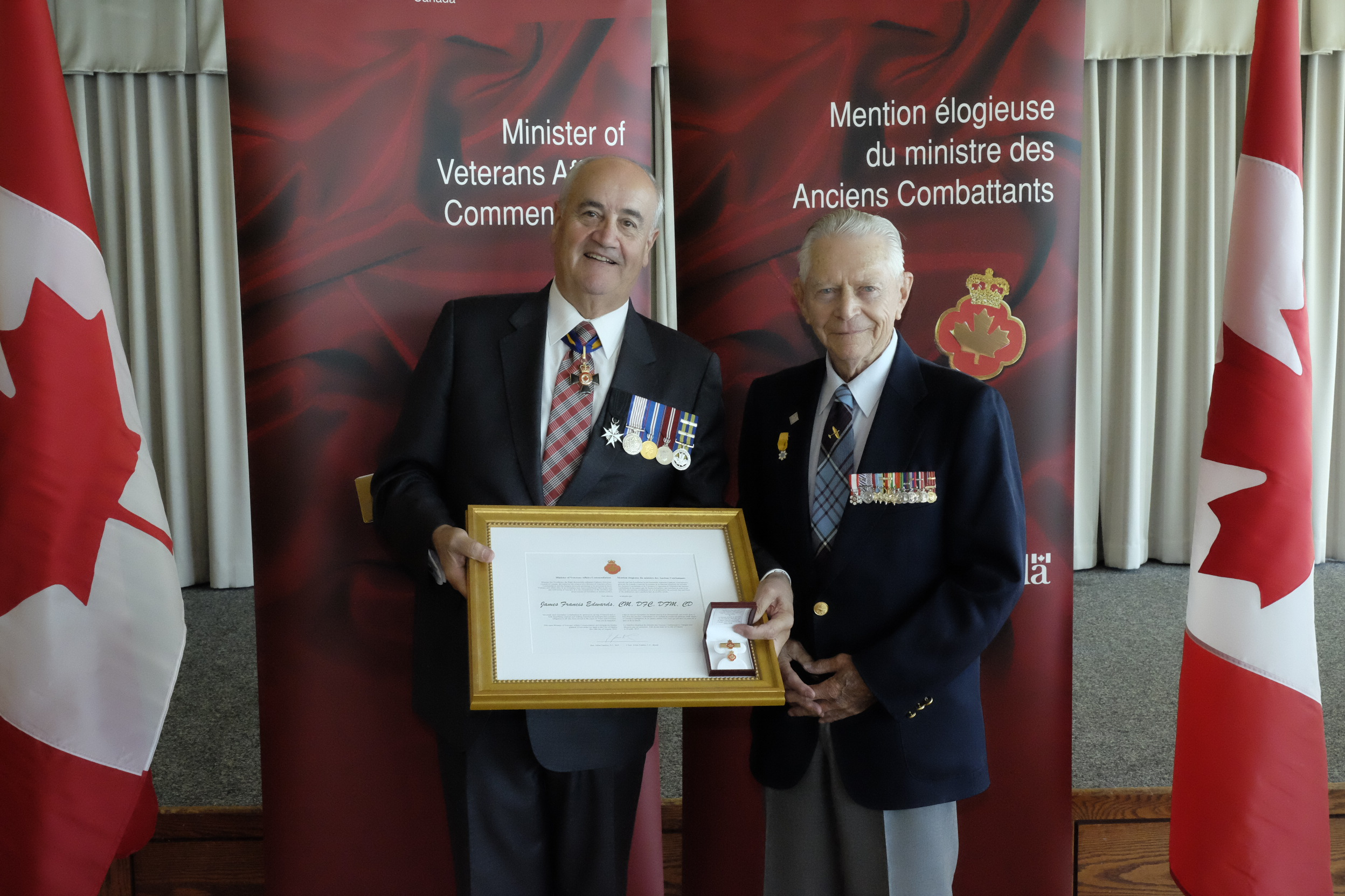 "Royal Canadian Air Force veteran James Francis ""Stocky"" Edwards (right) receives the Minister of Veterans Affairs Commendation from Minister Julian Fantino on September 12, 2014. PHOTO: Courtesy of Veterans Affairs Canada"