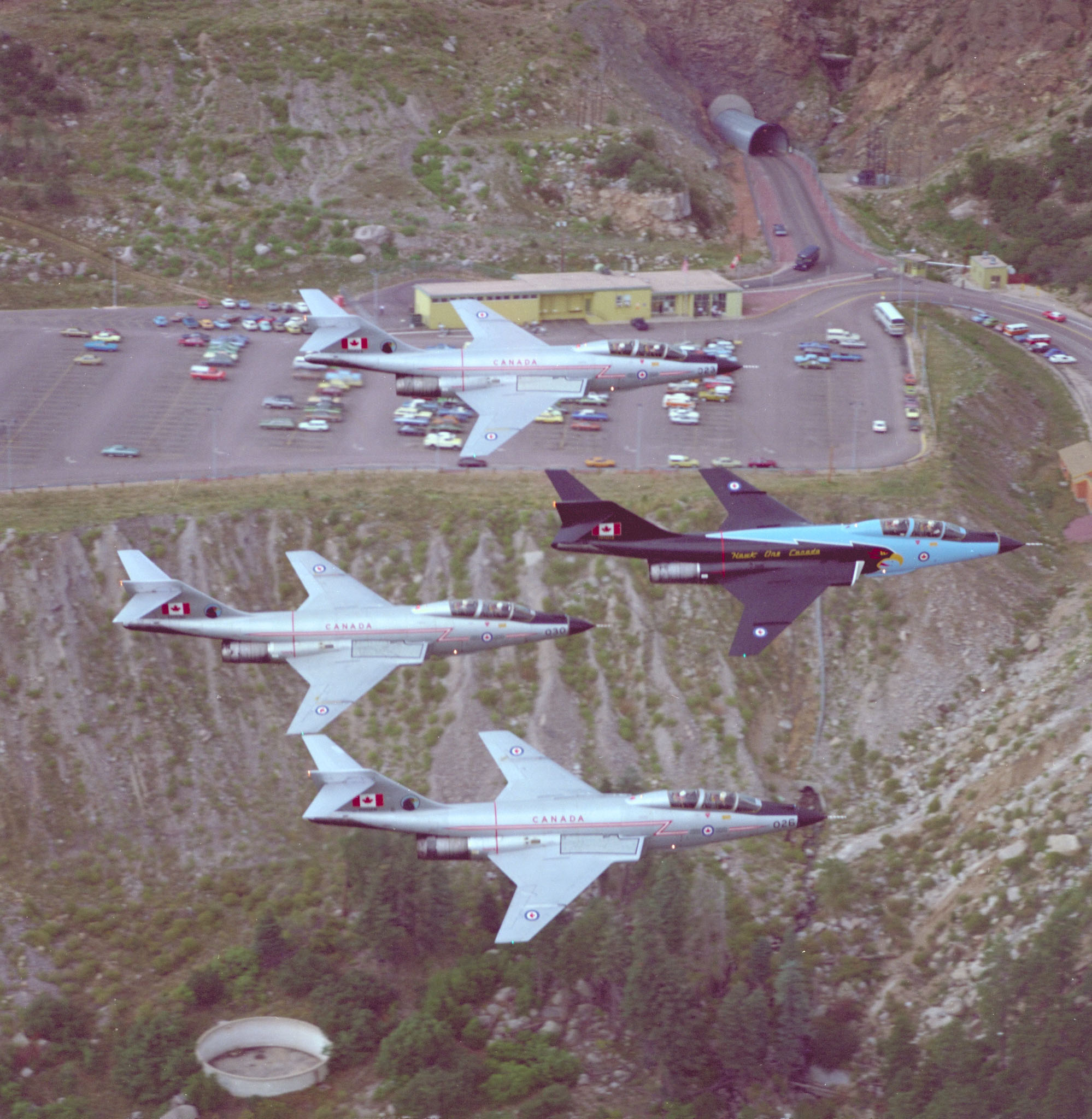 "409 Squadron's ""Hawk One"" leads the CF-101 Voodoo air display team past the entrance to the Cheyenne Mountain complex, the headquarters of NORAD in Colorado Springs, Colorado, circa 1977.  PHOTO: DND"