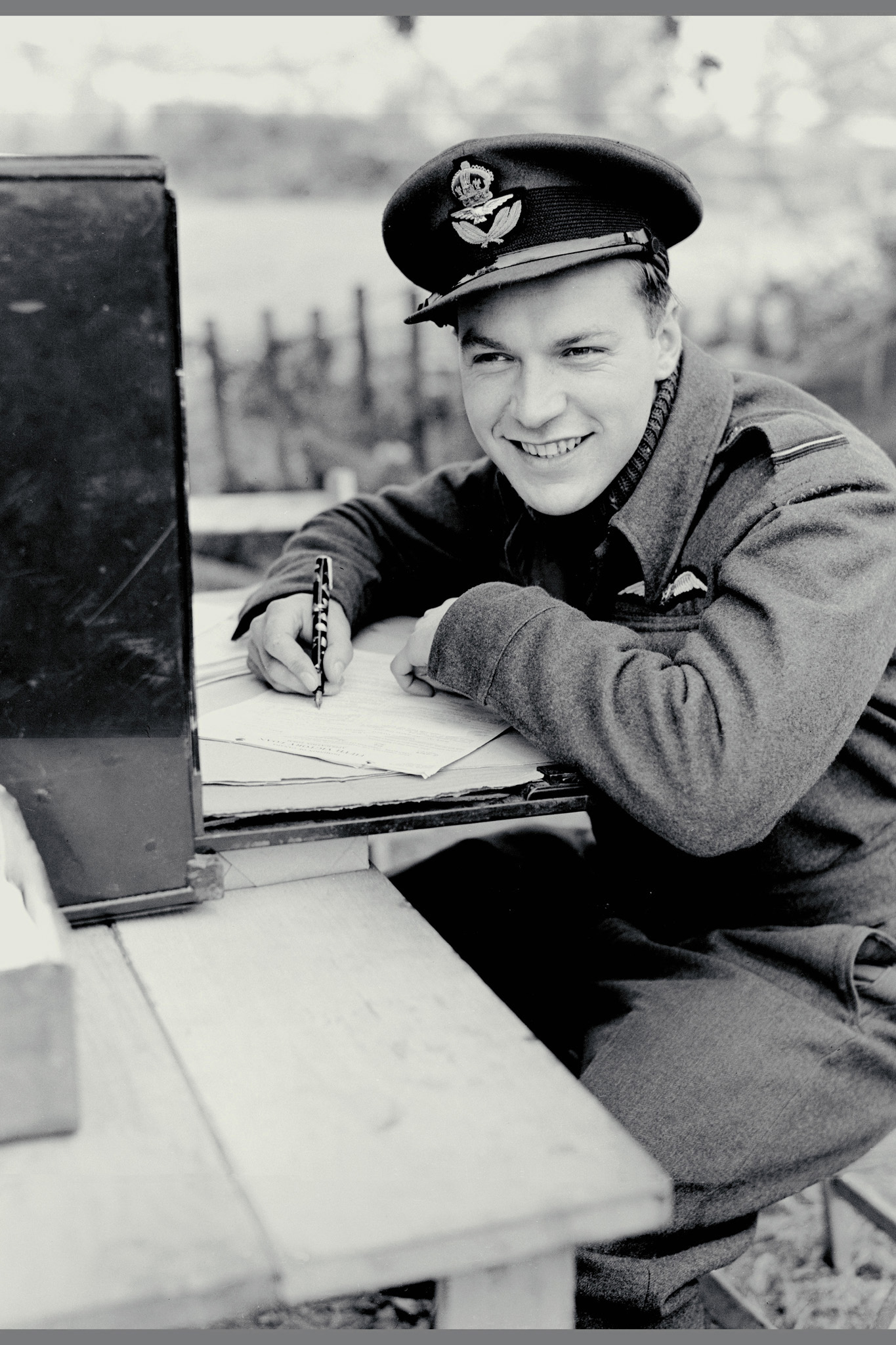 Flying Officer Robert Middlemiss subscribes to Canada's victory loan campaign in October, 1943, at an advanced Canadian airfield in England where fighter pilots spent the summer and autumn of 1943 in tents. He was on his second tour of operations when this photo was taken; his first was in Malta where he was shot down. Flying Officer Middlemiss retired from the RCAF in the rank of wing commander (lieutenant-colonel) in 1969 and became honorary colonel of 427 Special Operations Aviation Squadron in 2003. PHOTO: DND