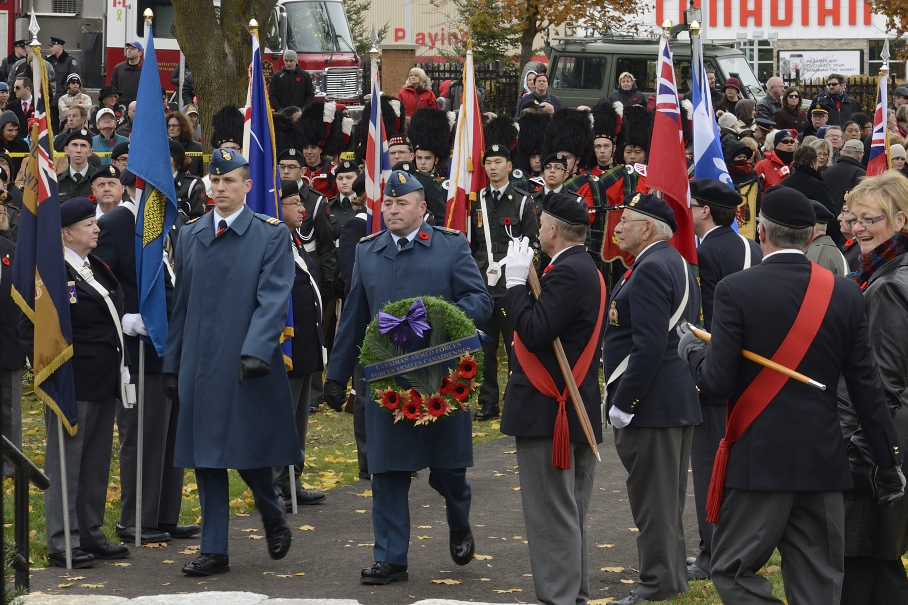 Accompanied by Warrant Officer John Meaney (left), Captain Kyle Pilatzke prepares to lay a wreath on behalf of the Canadian Armed Forces during the Remembrance Day parade in Aurora, Ontario, on November 11, 2014. PHOTO: MCpl Miranda Langguth