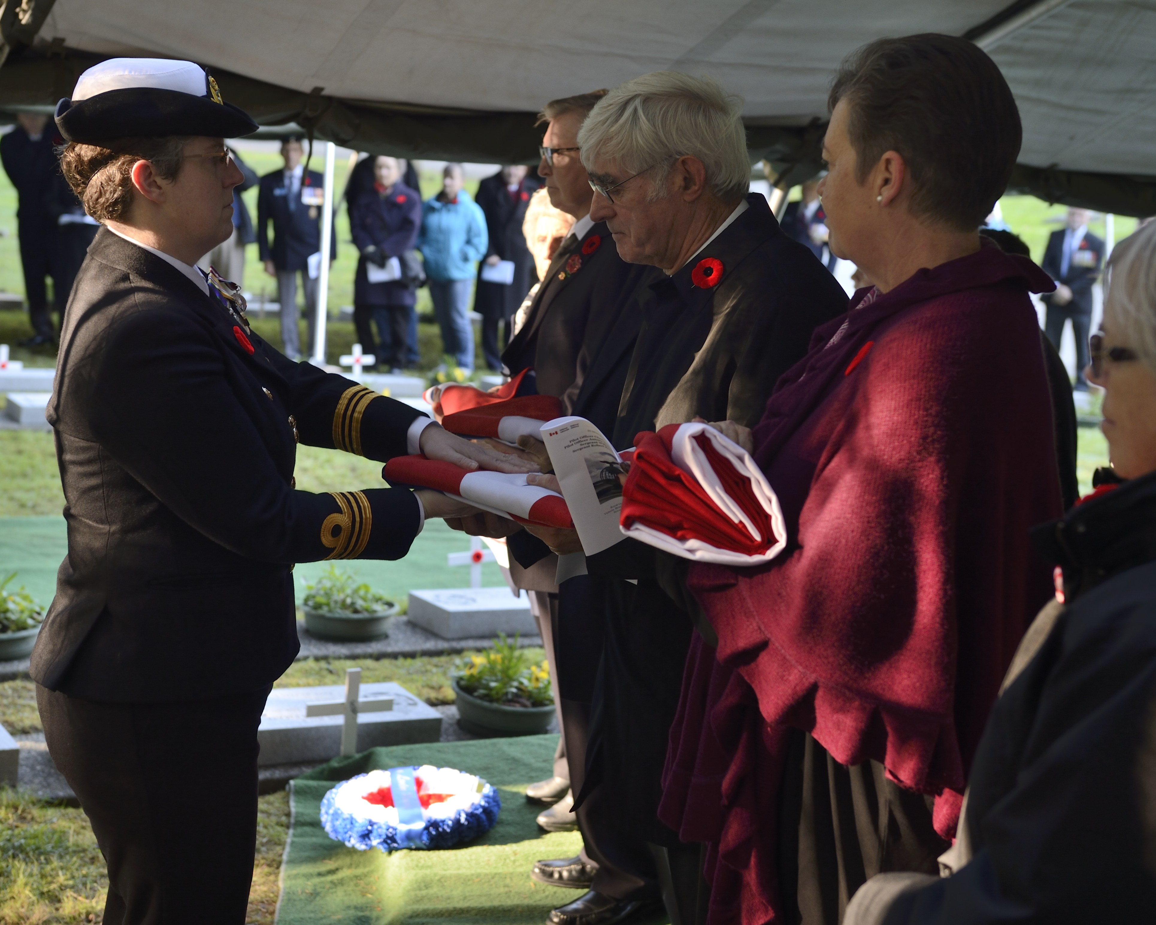Family members of the British and Canadian aircrew of Avro Anson flight L7056, lost over Vancouver Island, British Columbia on October 30, 1942, are presented with flags during the interment service for the four members of the aircrew, held on November 10, 2014, at Royal Oak Burial Park in Victoria, British Columbia. PHOTO: Corporal Malcolm Byers