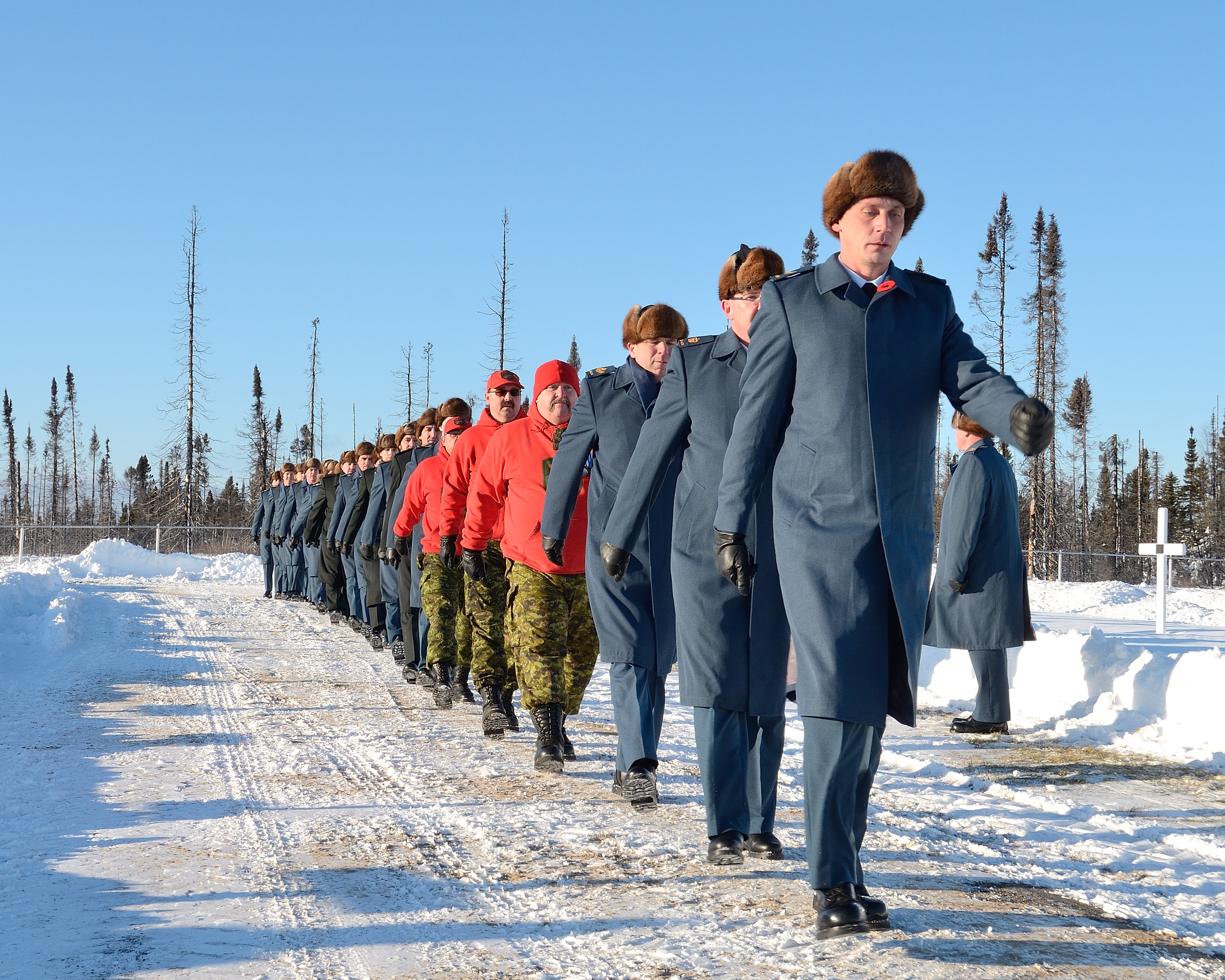 Royal Canadian Air Force members and Canadian Ranger personnel parade in Commonwealth Cemetery during the 5 Wing/Canadian Forces Base Goose Bay, Newfoundland and Labrador, Remembrance Day ceremony on November 11, 2014.