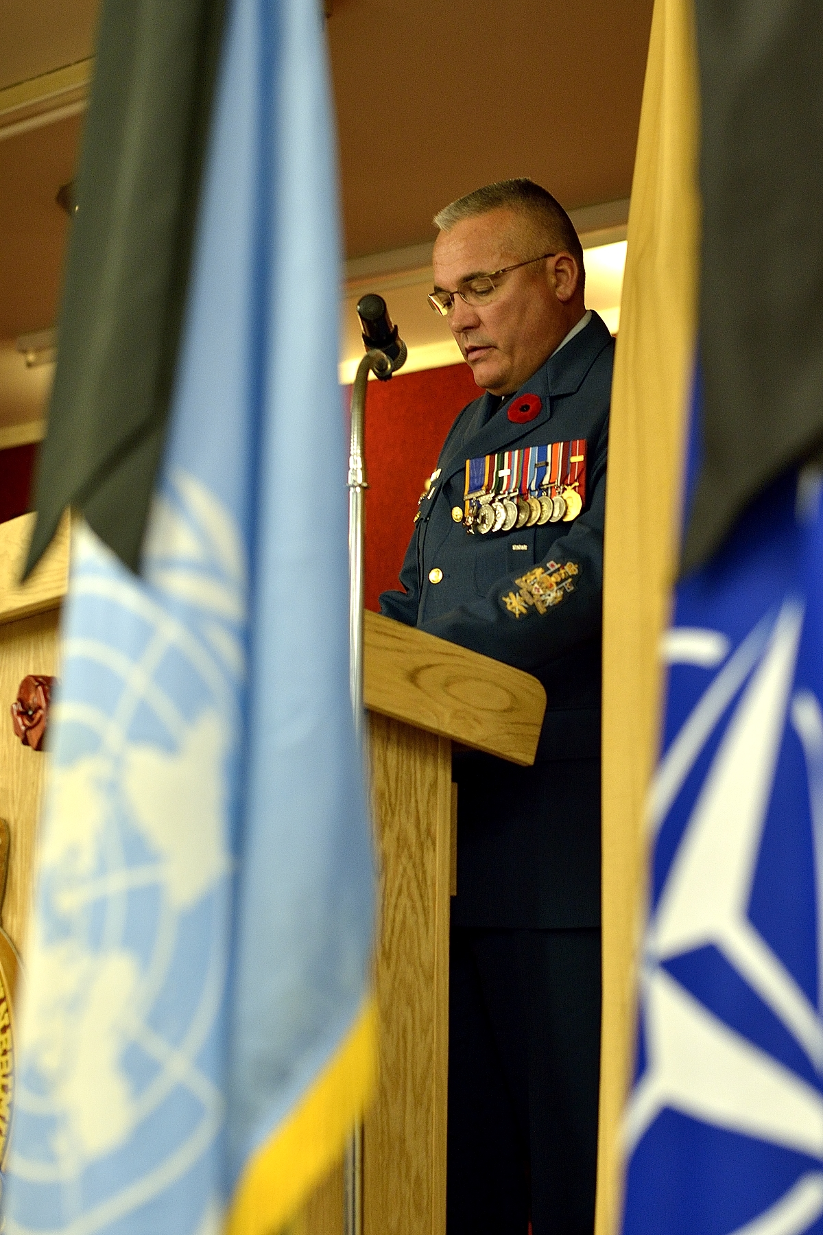 Chief Warrant Officer Pierrot Jetté, 14 Wing Greenwood Chief Warrant Officer, delivers an address during the Remembrance Day ceremony at the Royal Canadian Legion in Kingston, Nova Scotia, on November 11, 2014.