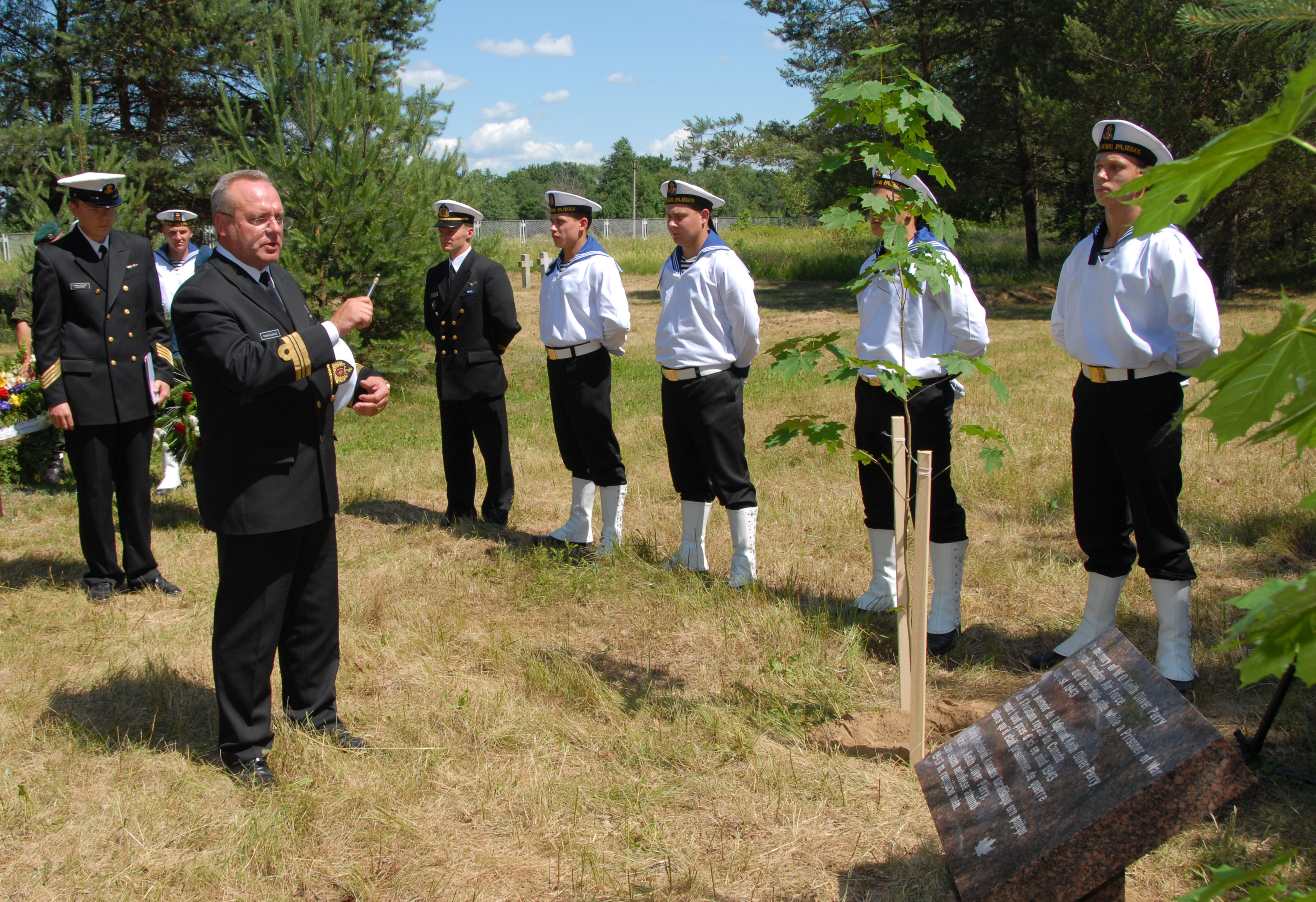 A Lithuanian naval chaplain blesses the memorial commemorating Warrant Officer Class 1 Perry in Macikai, Lithuania, during its unveiling in June 2007. PHOTO: DND