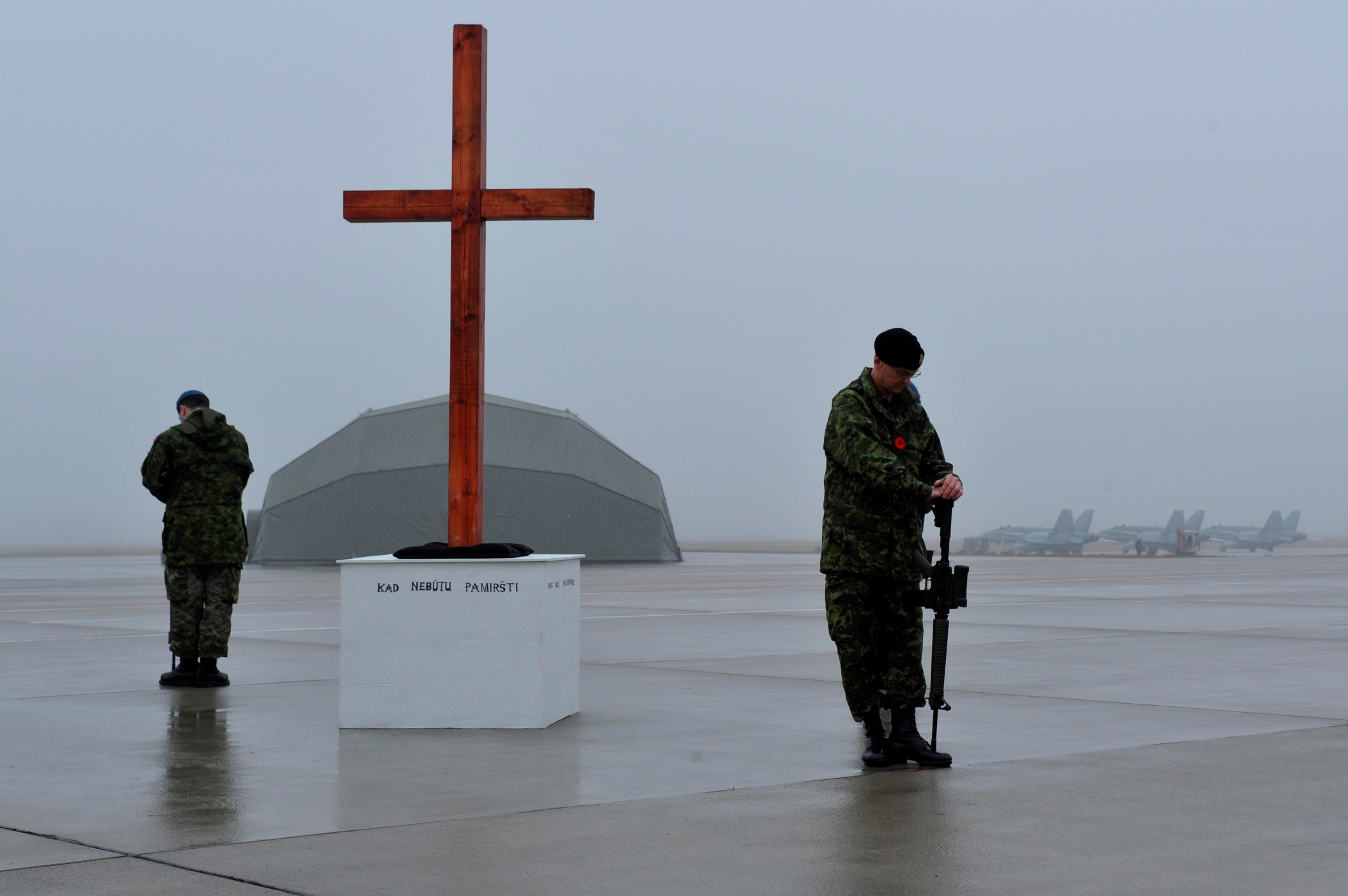 At Šiauliai Air Base in Lithuania, Canadian Air Task Force members deployed on Operation Reassurance stand sentry during the November 11, 2014, Remembrance Day ceremony. PHOTO: Air Task Force - Operation Reassurance, DND