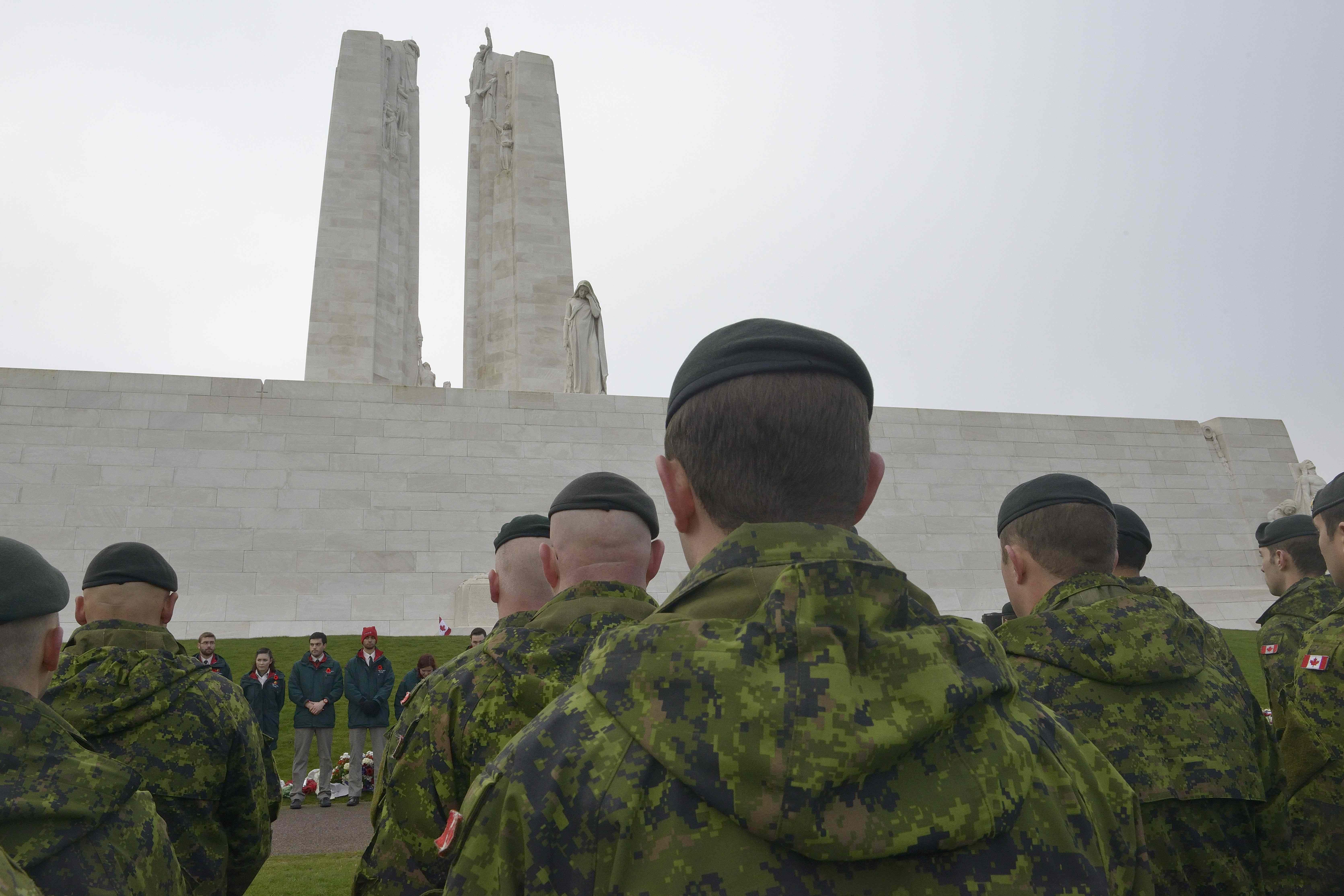 Canadian Armed Forces members deployed on Operation Reassurance take part in a Remembrance Day ceremony at Vimy Ridge, France, on November 11, 2014. PHOTO: Land Task Force - Operation Reassurance, DND
