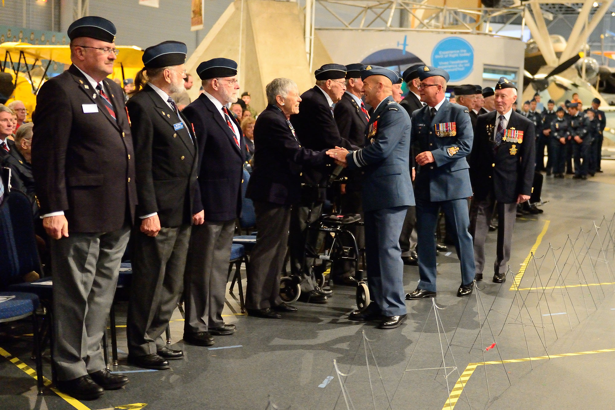 Lieutenant-General Yvan Blondin, Commander Royal Canadian Air Force, greets veterans during the 2014 Battle of Britain Ceremony at the Canada Aviation and Space Museum in Ottawa, Ontario. PHOTO: Corporal Chase Miller
