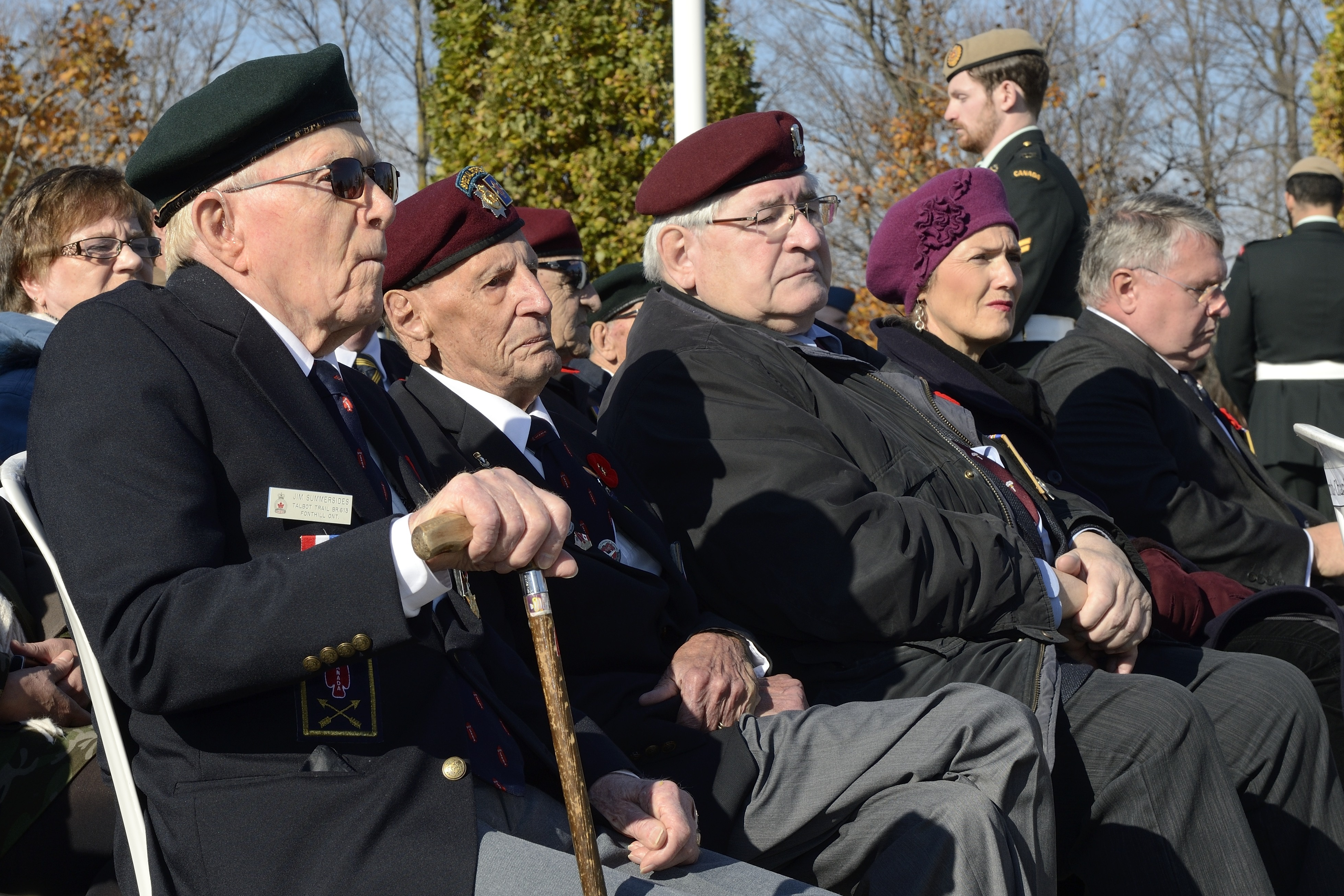 "Mr. Jim Summersides (left), Mr. Ralph Mayville, and Mr. Wil Paquette, former members of the 1st Special Service Force, ""Devil's Brigade"" at the Remembrance Day Ceremony on November 11, 2014 at the Beechwood Military Cemetery in Ottawa, Ontario. PHOTO: Corporal Lisa Fenton"