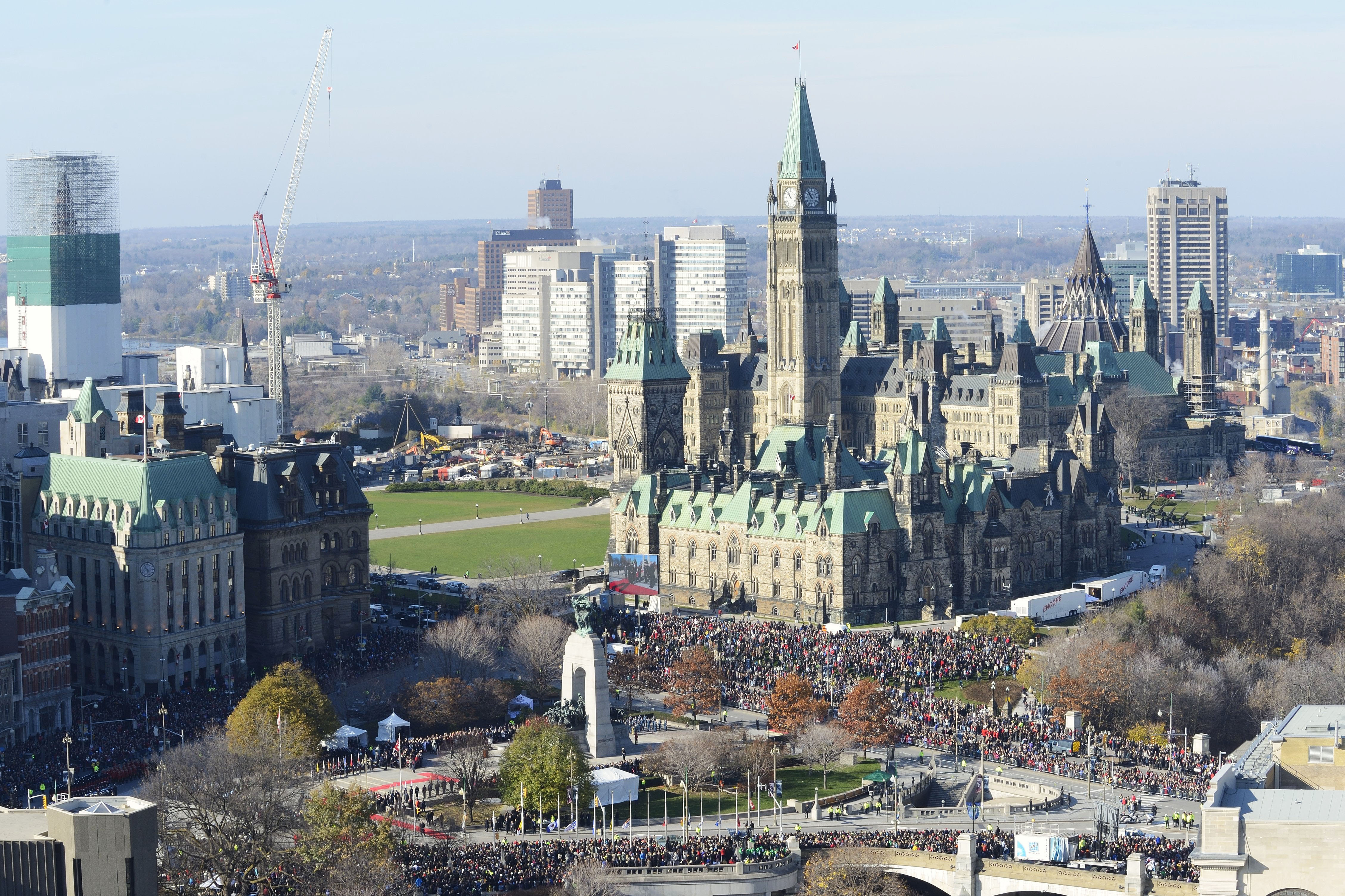 On November 11, 2014, National Remembrance Day Ceremony attendees surround the National War Memorial in downtown Ottawa, Ontario, and spill over onto Parliament Hill. An estimated 50,000 people turned out for the ceremony.