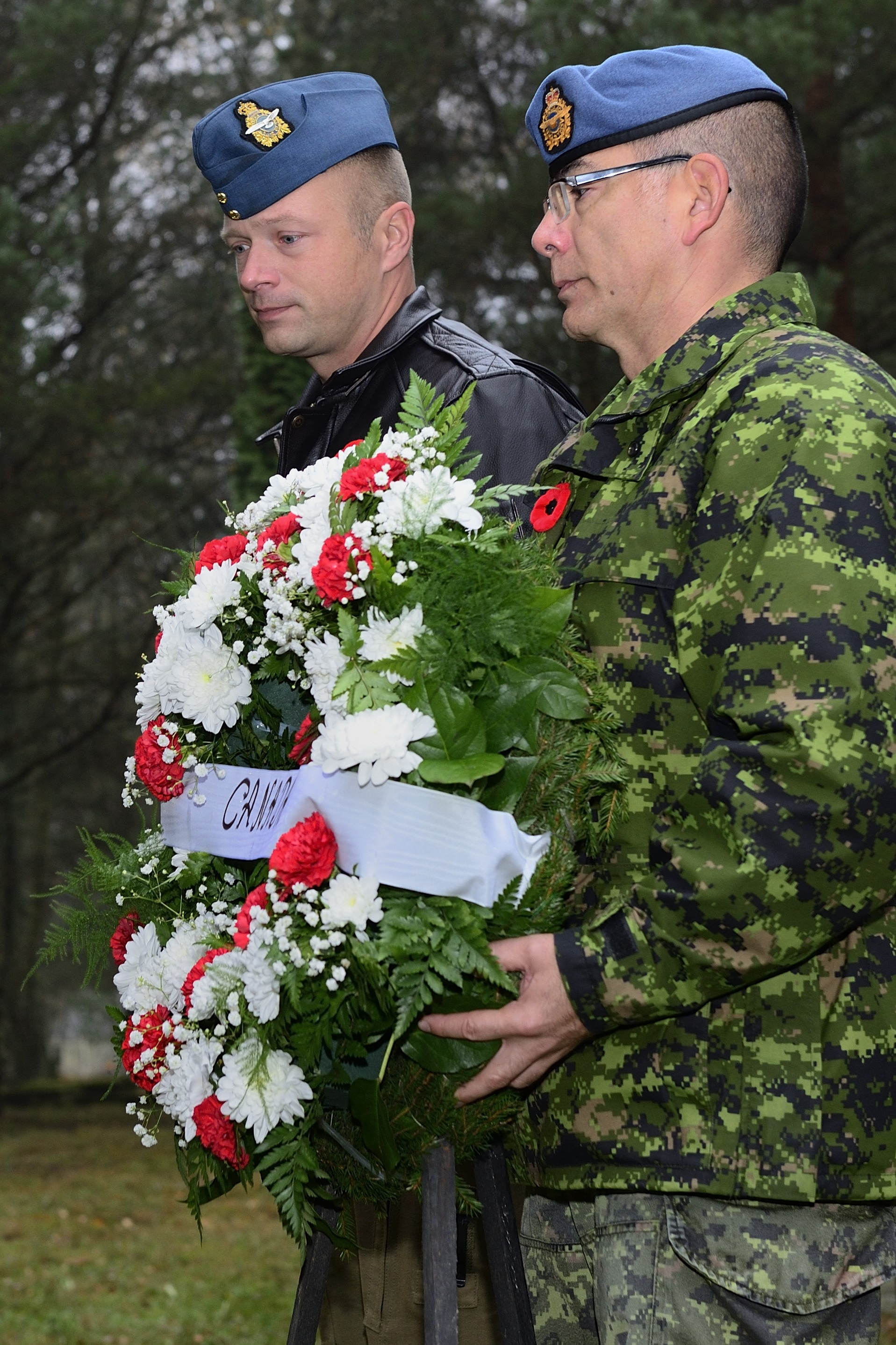 Lieutenant-Colonel David Pletz, the commander of Air Task Force-Lithuania, and Chief Warrant Officer Alain Roy, the chief warrant officer of the Task Force, prepare to lay a wreath at a memorial commemorating Warrant Officer Class 1 Keith Oliver Perry, who died in prisoner of war camp in 1943 in what is now Lithuania. PHOTO: Air Task Force Lithuania