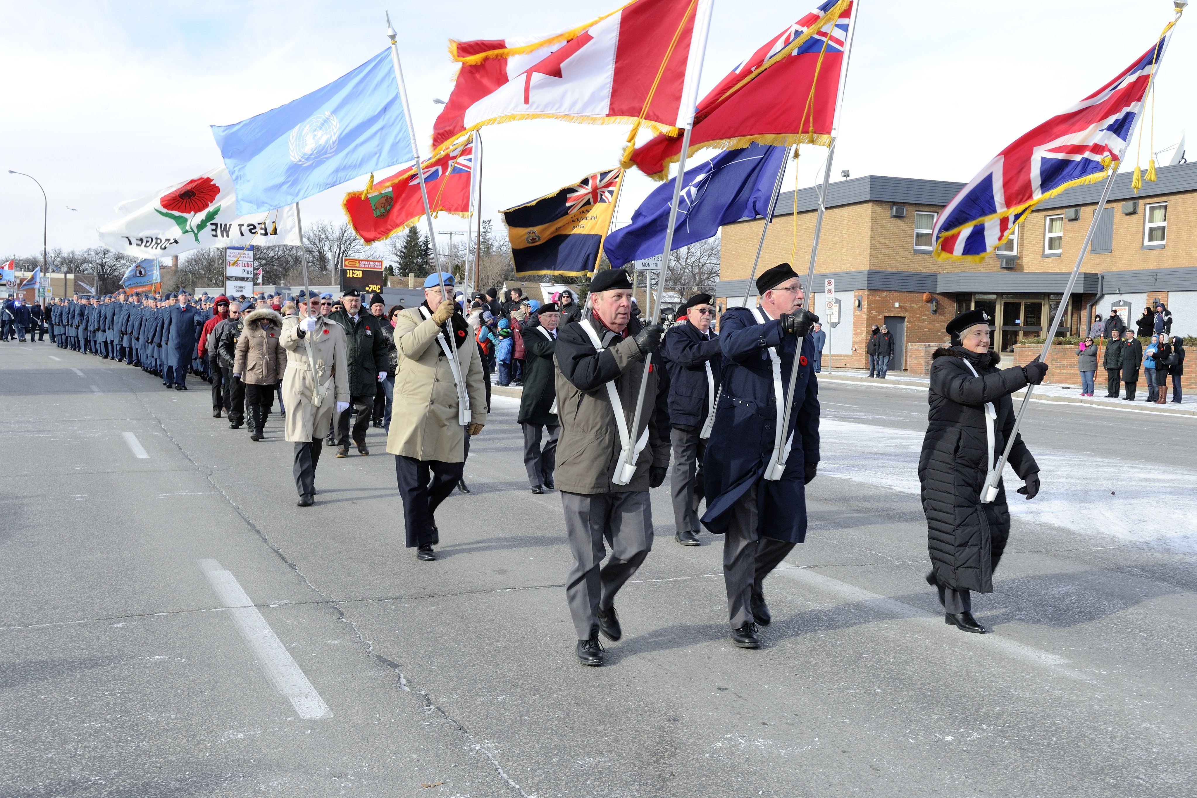 The Colour Party leads the Remembrance Day parade at Bruce Park on November 11, 2014 in Winnipeg, Manitoba. PHOTO: Private Darryl Hepner