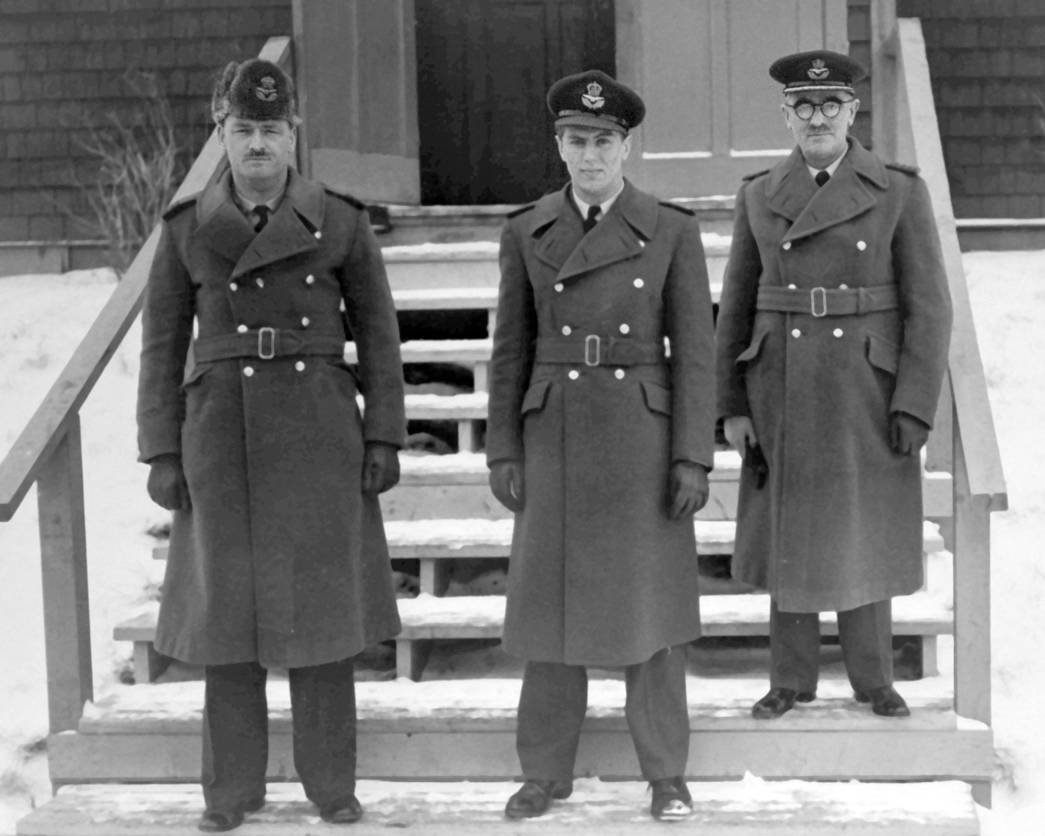 "On February 28, 1943, during a Victory Loan Drive selling war bonds, Canadian air ace Flying Officer George ""Buzz"" Beurling (centre) visits No. 34 Service Flying Training School at RCAF Medicine Hat, Alberta, with Group Captain A. Ellis (left) and Wing Captain Scragg. PHOTO: DND Archives"