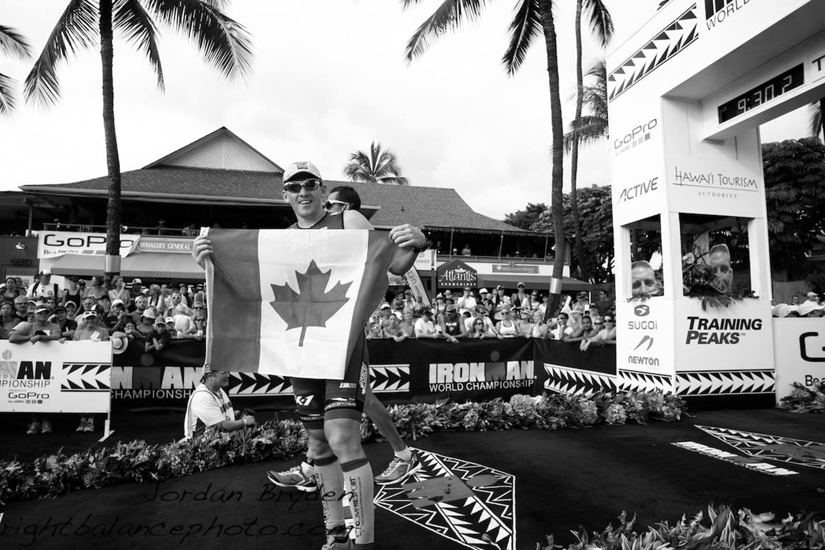 Major Joel Maley finishes Ironman 2014 with the flag in Kailua-Kona, Hawaii, USA.