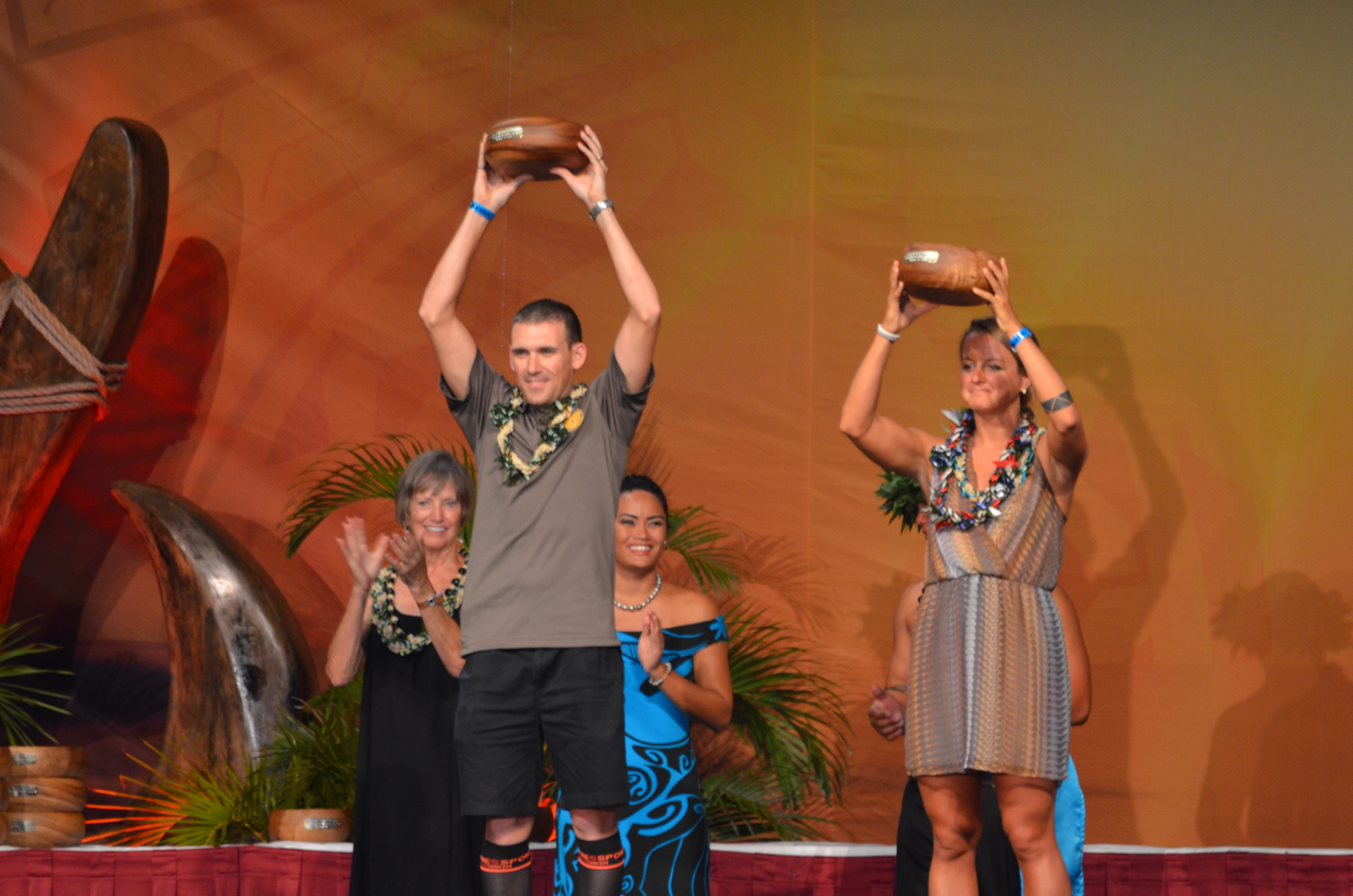 "The winners in the Ironman World Championship 2014 military division, Canada's Major Joel Maley, and Samantha Morrison, of the United States Air Force, display the traditional ""winners' cups"", wooden Uemke bowls. PHOTO: Claudia Maley"