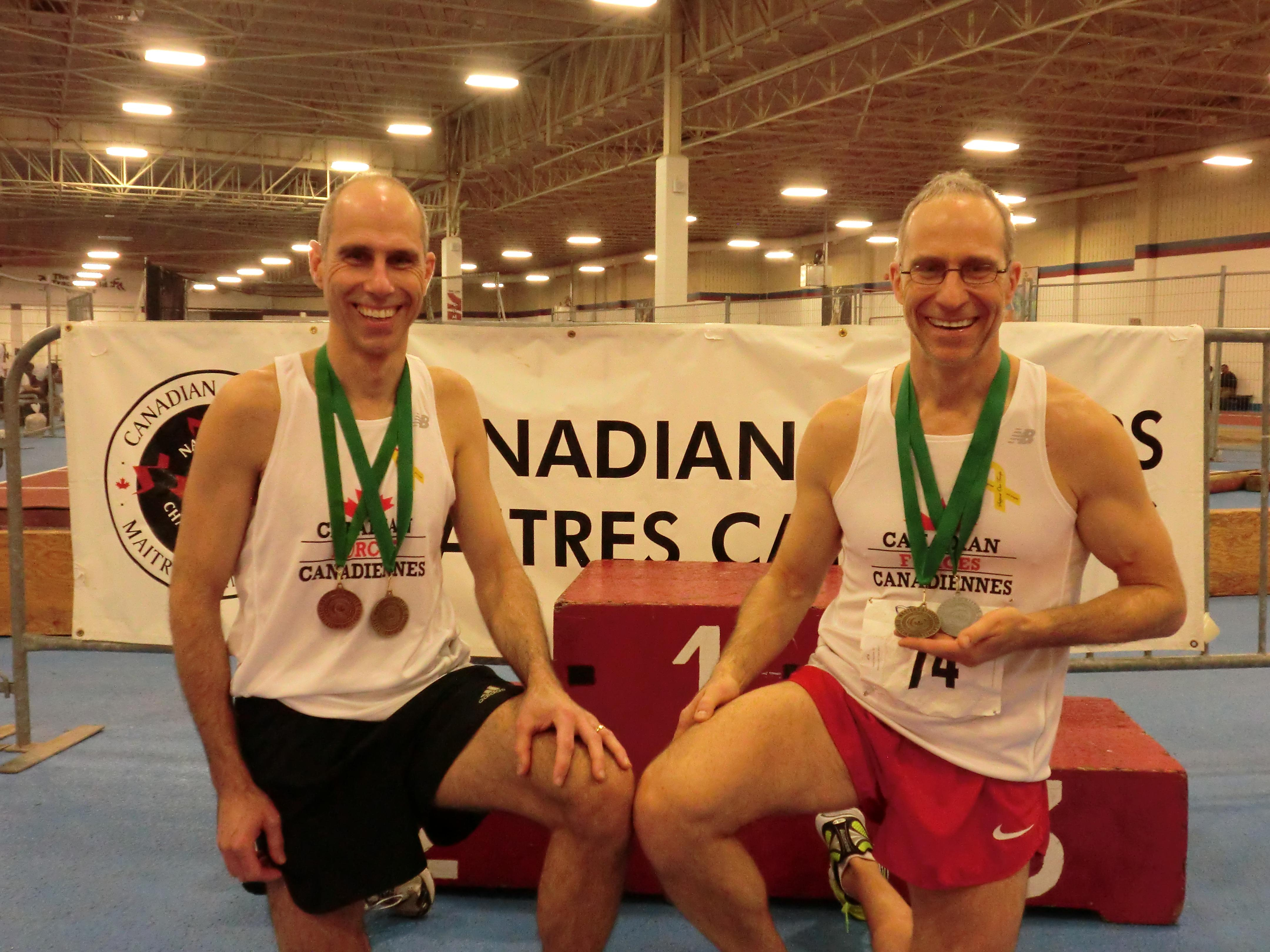 Royal Canadian Air Force brothers Master Warrant Officer Claude Faucher (left) and Major Serge Faucher display their medals at the Canadian Masters Athletics Indoor Championships held March 14 at the Toronto, Ontario, Track and Field Centre.