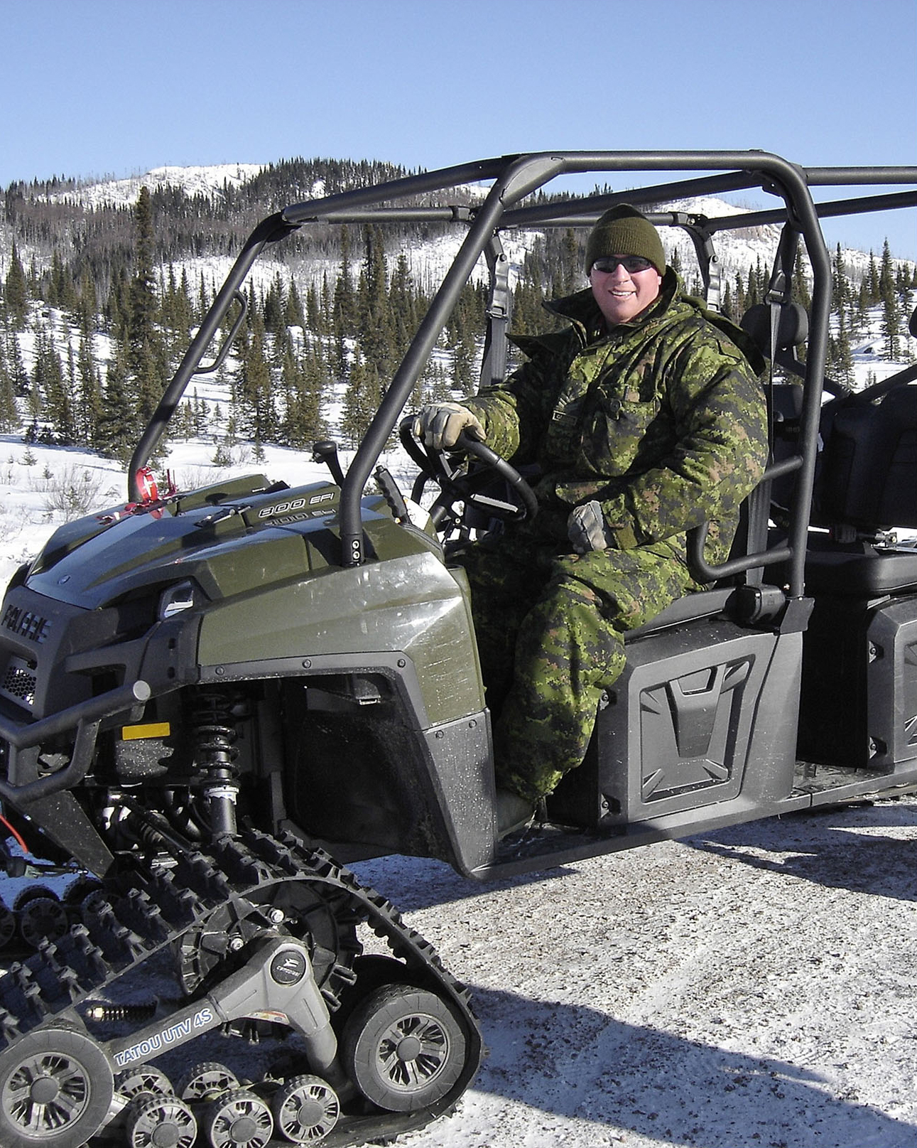 A military member uses a Utility Terrain Vehicle to travel in deep snow off-road during winter. Effective, adaptable means of transportation are crucial to military operations in Labrador. PHOTO: DND